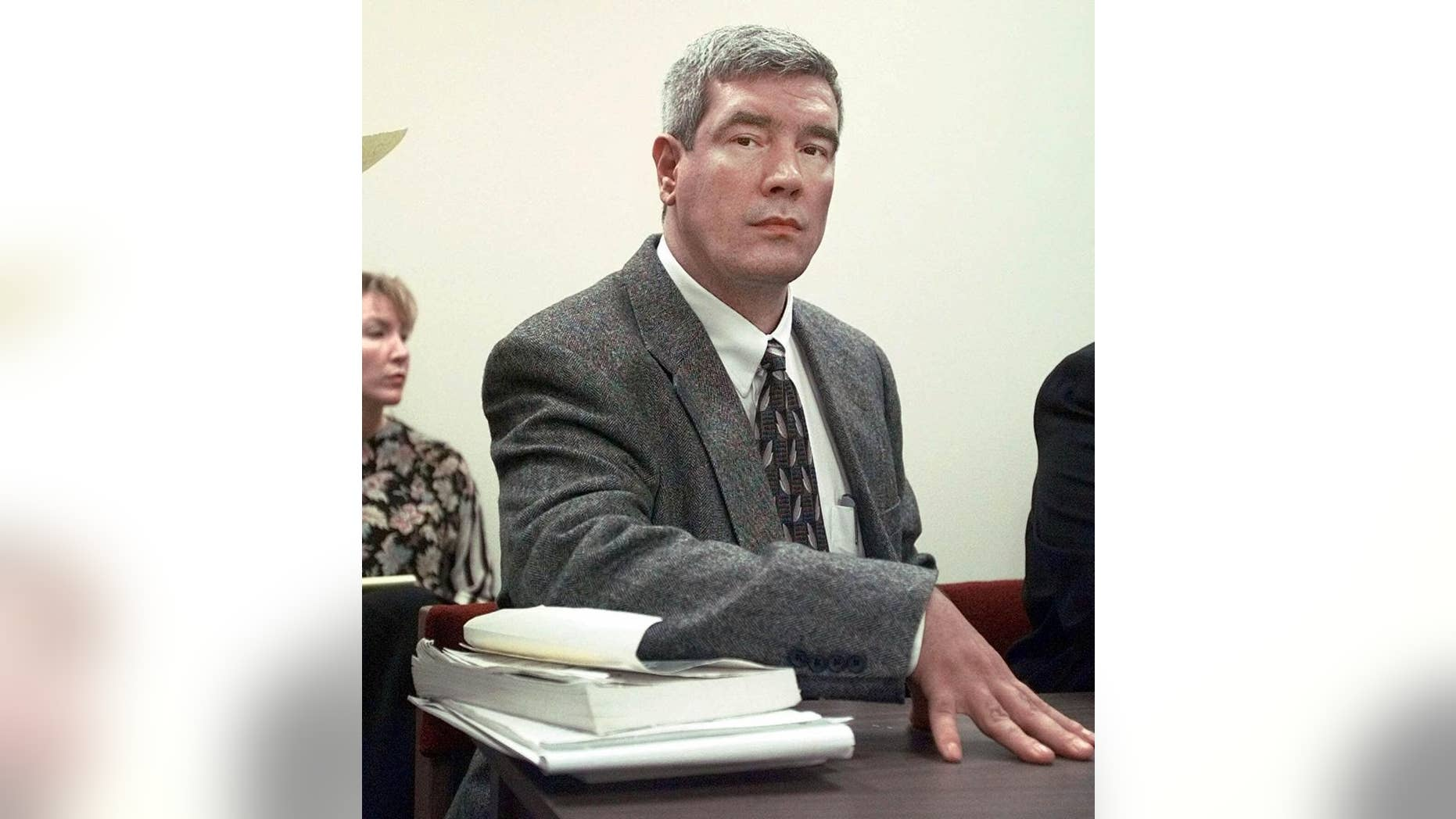 FILE - In this Feb. 8, 1999, file photo, Kerry Max Cook is seen sitting in a courtroom in Bastrop, Texas. A judge on Monday, June 6, 2016, has dismissed murder charges against Cook, who previously was convicted and almost executed in the 1977 East Texas slaying of a 21-year-old woman. The order said Cook's rights were violated, in part by false testimony during his trial. (AP Photo/LM Otero, File)
