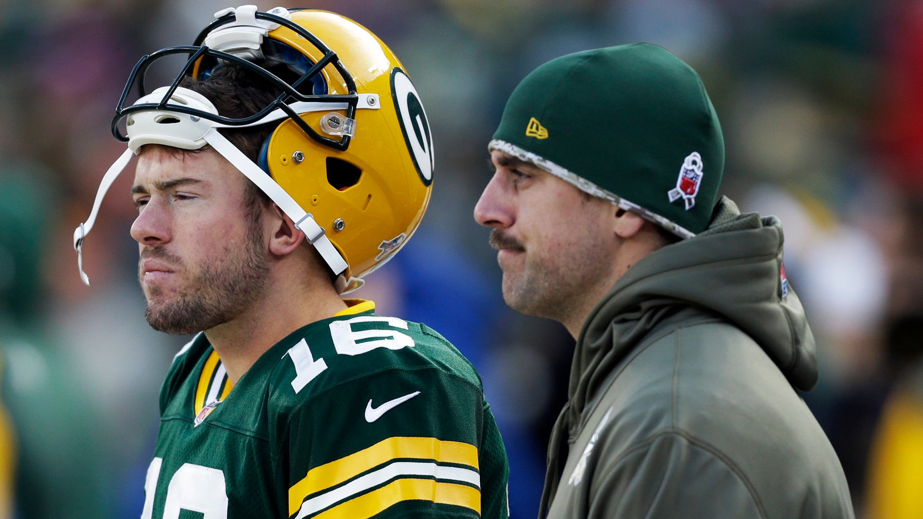 Green Bay Packers' Aaron Rodgers and Scott Tolzien watch from the sidelines during the second half of an NFL football game against the Philadelphia Eagles Sunday, Nov. 10, 2013, in Green Bay, Wis. The Eagles won 27-13. (AP Photo/Mike Roemer)