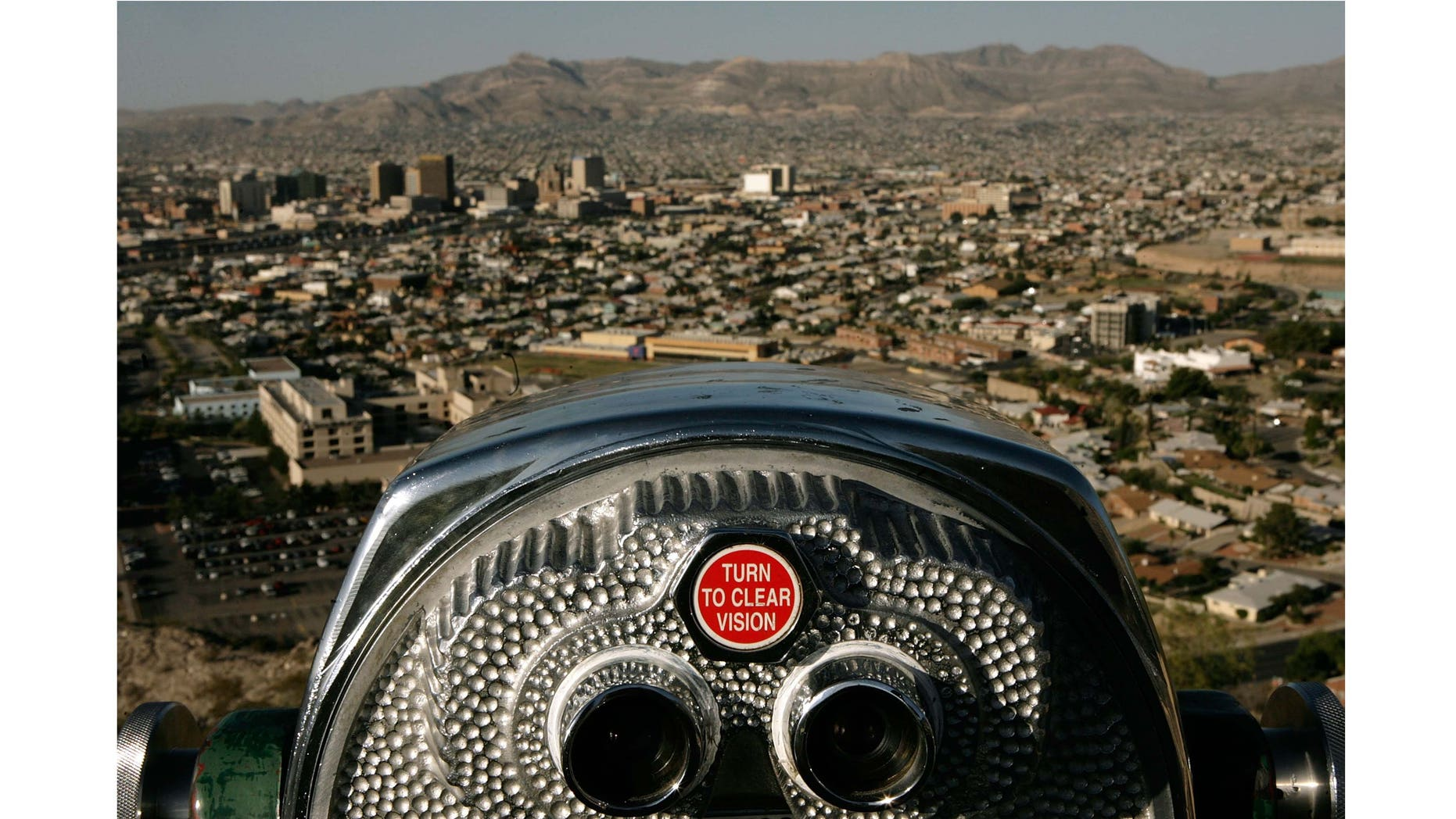 EL PASO, TX - JUNE 26:  Early morning light falls over the combined cities of El Paso, Texas, and Ciudad Juarez, Mexico, as seen from the Franklin Mountains June 26, 2007 in El Paso,Texas. Separated by the Rio Grande, the two cities have a combined population of more than 2 million people, with 80 percent of those people being native Spanish speakers. Since the attacks of September 11, 2001, enforcement of the U.S.-Mexico border by the Customs and Border Protection agency has increased, sharply reducing the illegal entry of people and drugs into the United States. (Photo by Chip Somodevilla/Getty Images)