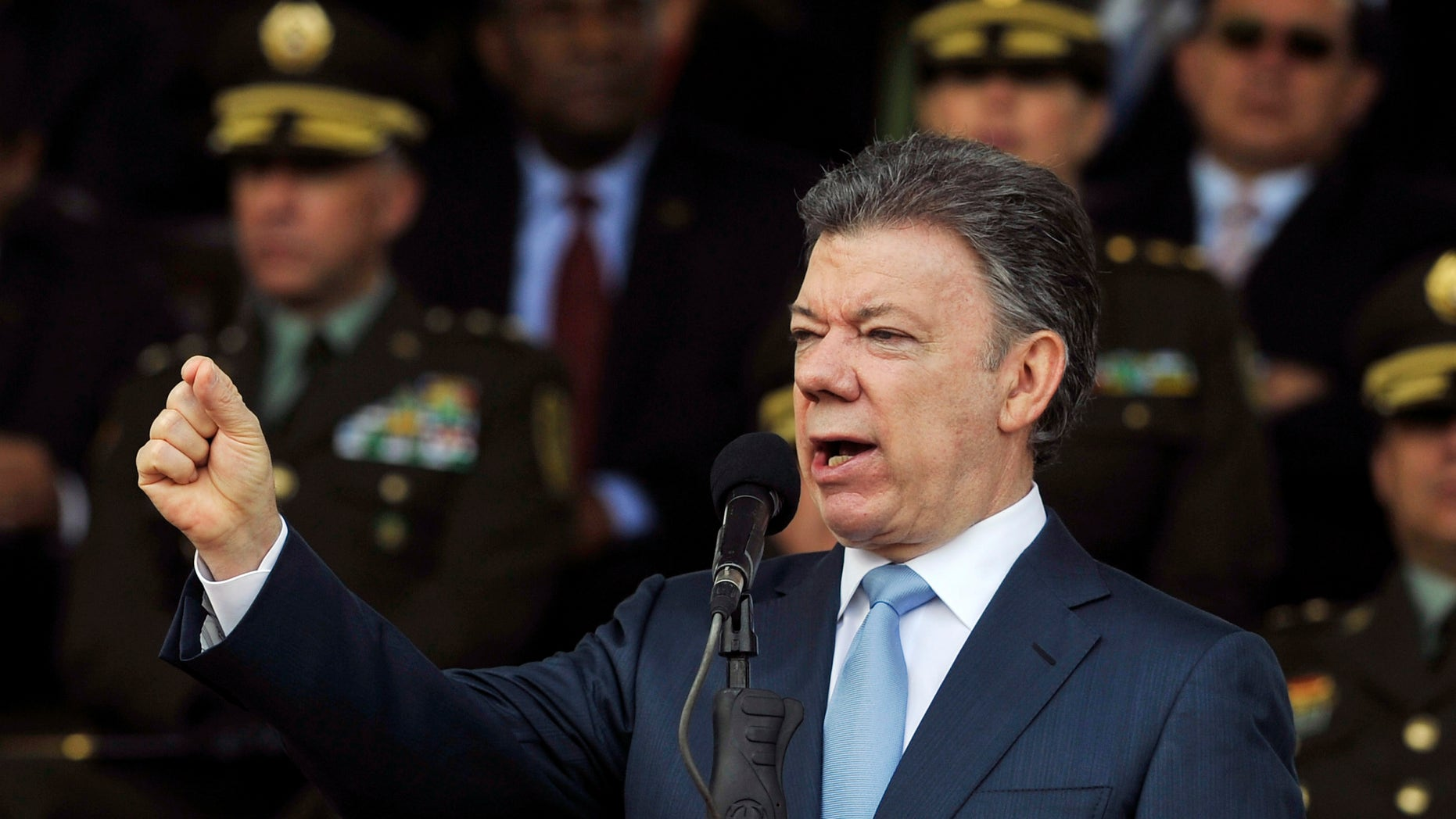 FILE - In this Nov. 6, 2013 file photo, Colombia's President Juan Manuel Santos speaks during a graduation ceremony for police cadets in Bogota, Colombia. Santos announced on Wednesday, Nov. 20, 2013 that he will run for reelection in 2014. (AP Photo/Carlos Julio Martinez, File)