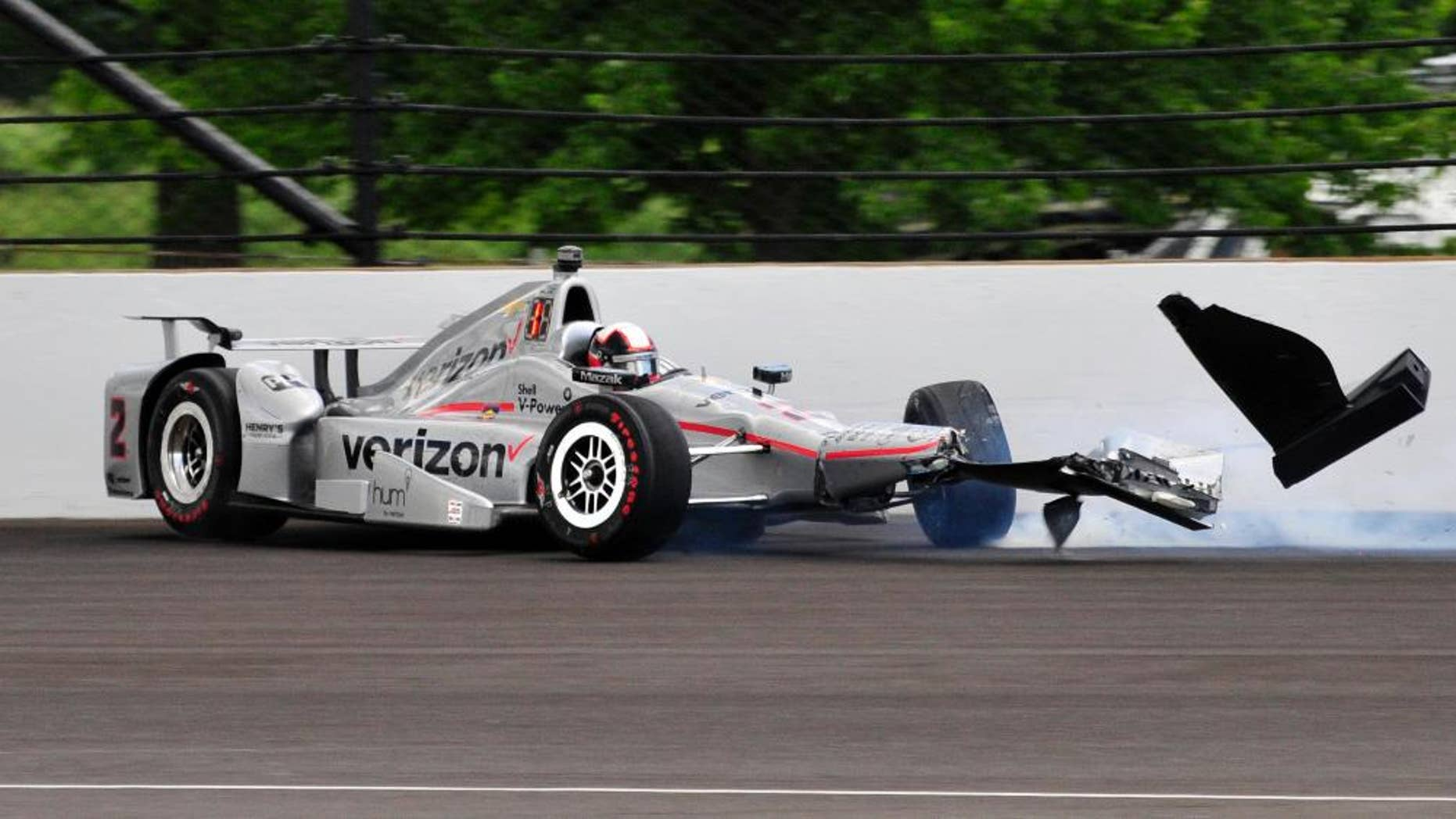 The car driven by Juan Pablo Montoya, of Colombia, hits the wall int he second turn during the 100th running of the Indianapolis 500 auto race at Indianapolis Motor Speedway in Indianapolis, Sunday, May 29, 2016. (AP Photo/John Maxwell)
