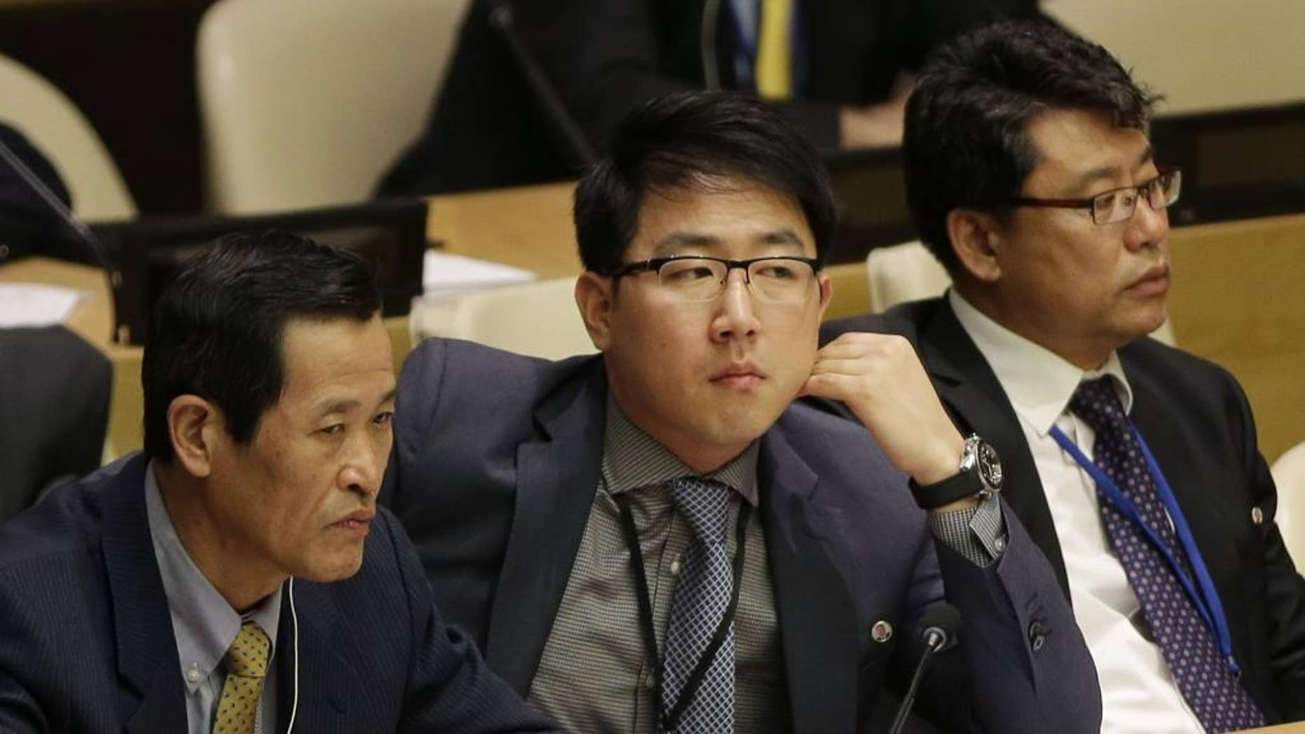 Kim Ju Song, a member of the North Korea delegation, attends a panel discussion on human rights abuses in North Korea at United Nations headquarters, Wednesday, Oct. 22, 2014. (AP Photo/Seth Wenig)
