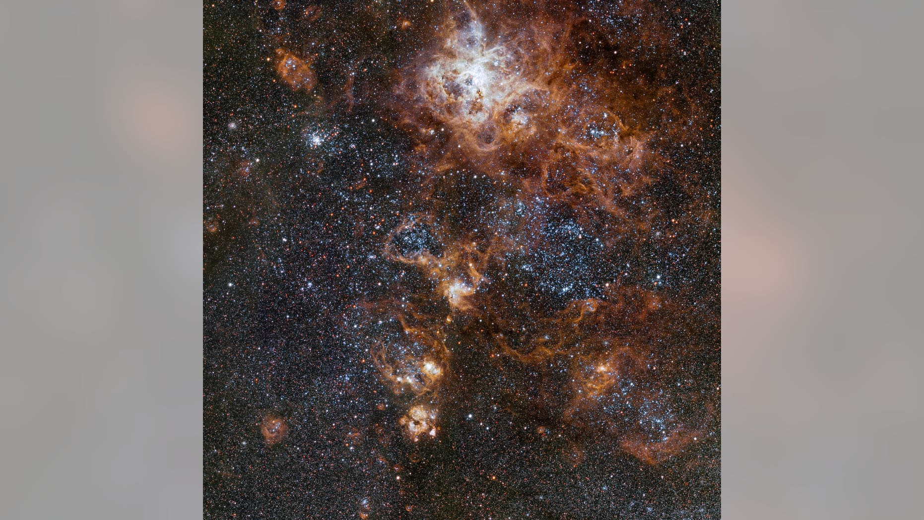 This image from VLT Survey Telescope at ESO'S Paranal Observatory in Chile showcases the brilliant Tarantula Nebula in the Large Magellanic Cloud.