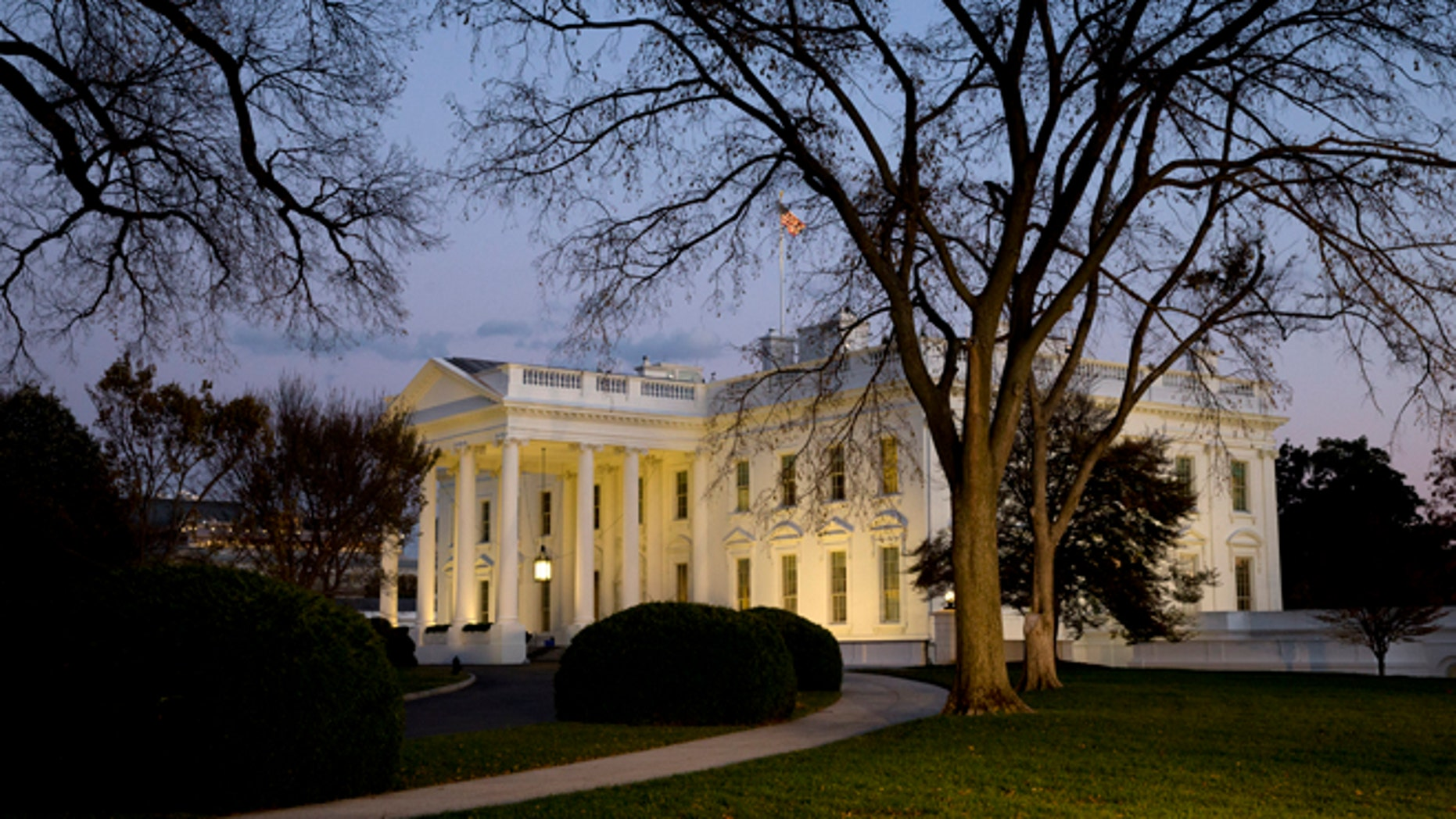 FILE - This Nov. 20, 2014, file photo shows the White House at sunset in Washington. After taking a shellacking in the November midterm elections, many Democrats remain confident that the 2016 presidential landscape still tilts in their favor. Republicans, meanwhile, are out to disprove the idea of an enduring âObama coalition.â (AP Photo/Jacquelyn Martin, File)