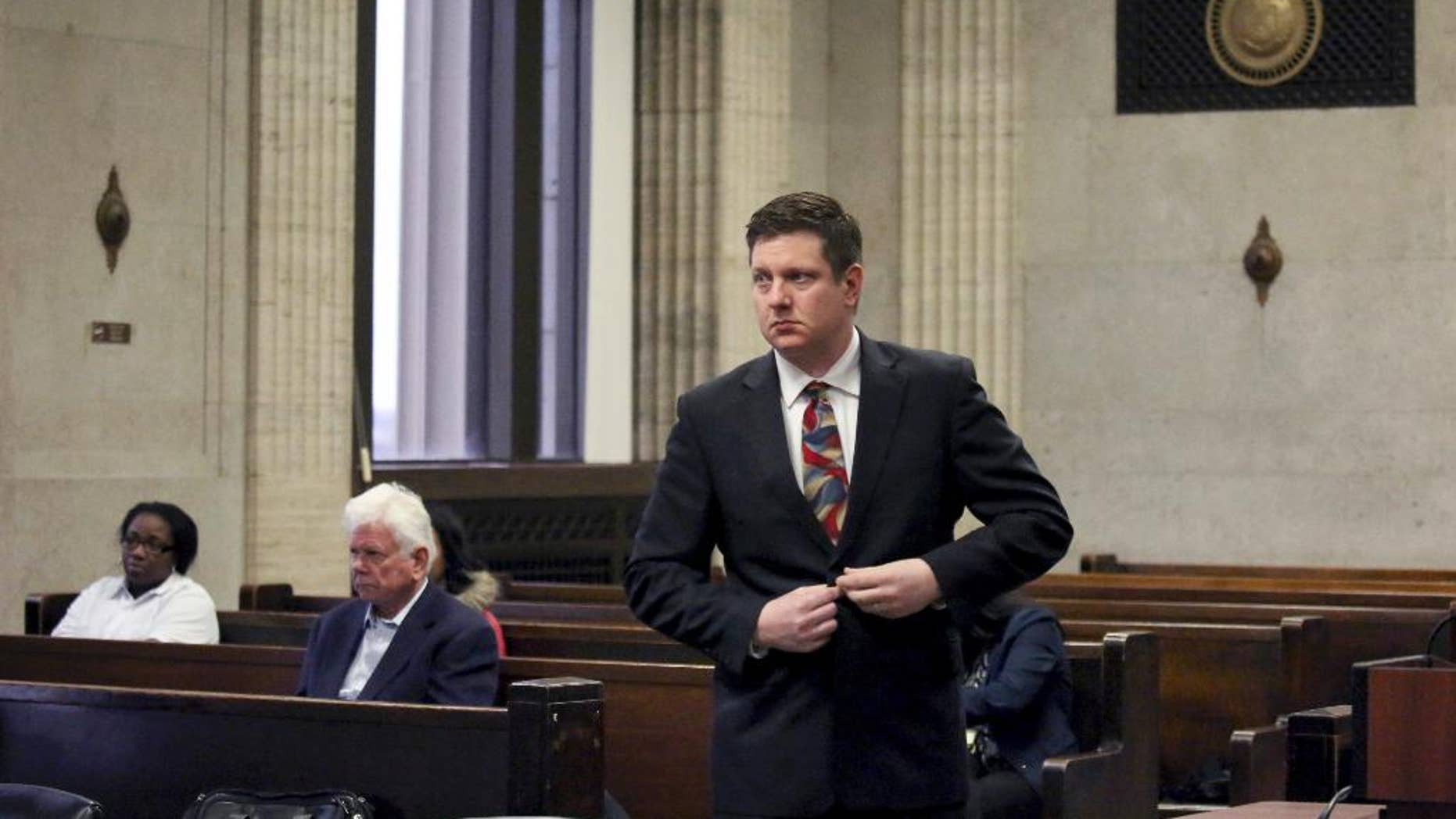 Chicago Police Officer Jason Van Dyke approaches the bench for his hearing with Judge Vincent Gaughan at the Leighton Criminal Courts Building in Chicago Tuesday Jan. 10, 2017, in Chicago. Van Dyke is charged with murder in the October 2014 death of Laquan McDonald, who was shot 16 times. The Cook County judge on Tuesday ordered the release of McDonald's juvenile records, except for records about his birth mother and sister. (Nancy Stone/Chicago Tribune via AP, Pool)