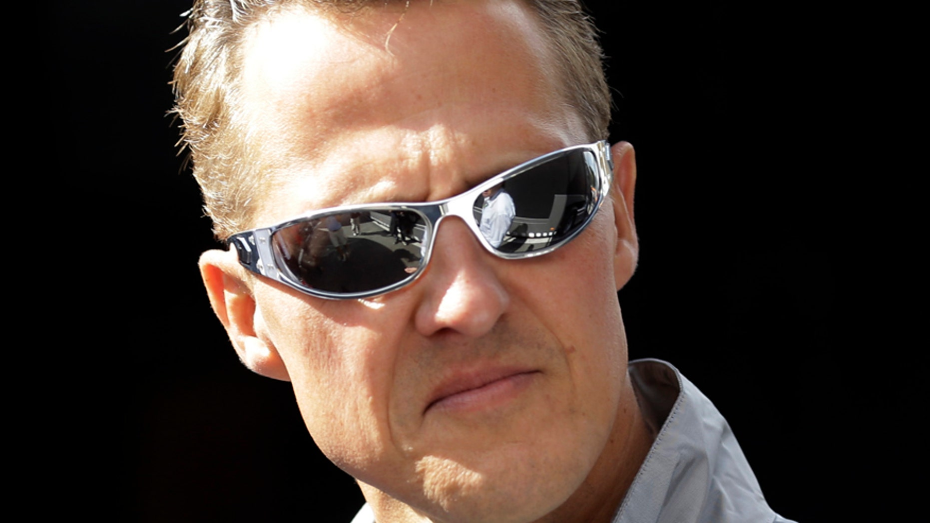 FILE - In this Thursday, Aug. 30, 2012 file photo, former Mercedes Grand Prix driver Michael Schumacher of Germany, looks on ahead the Belgium Formula One Grand Prix in Spa-Francorchamps circuit , Belgium.  Former Formula One world champion Michael Schumacher has left hospital to continue his recovery at home, his manager said Tuesday. The seven-time champion suffered a serious head injury while skiing in France in December, resulting in him being put in a coma. (AP Photo/Luca Bruno, File)