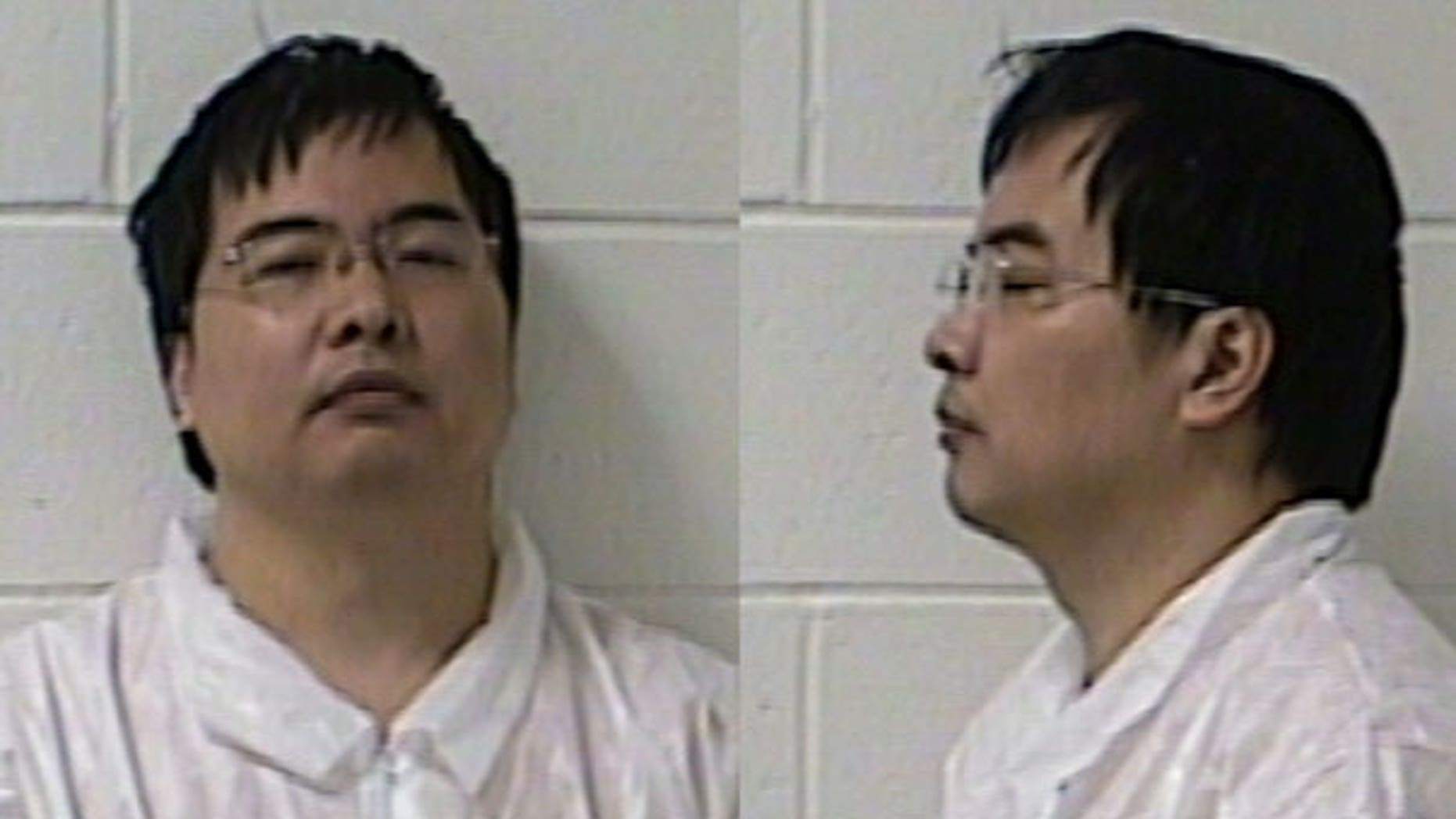 April 26: Lishan Wang is seen in two booking photos. Branford police say Wang, a citizen of China, is charged with murder, attempted murder and firearms offenses in the fatal shooting of Vajinder Toor outside Toor's home in Branford, Conn.