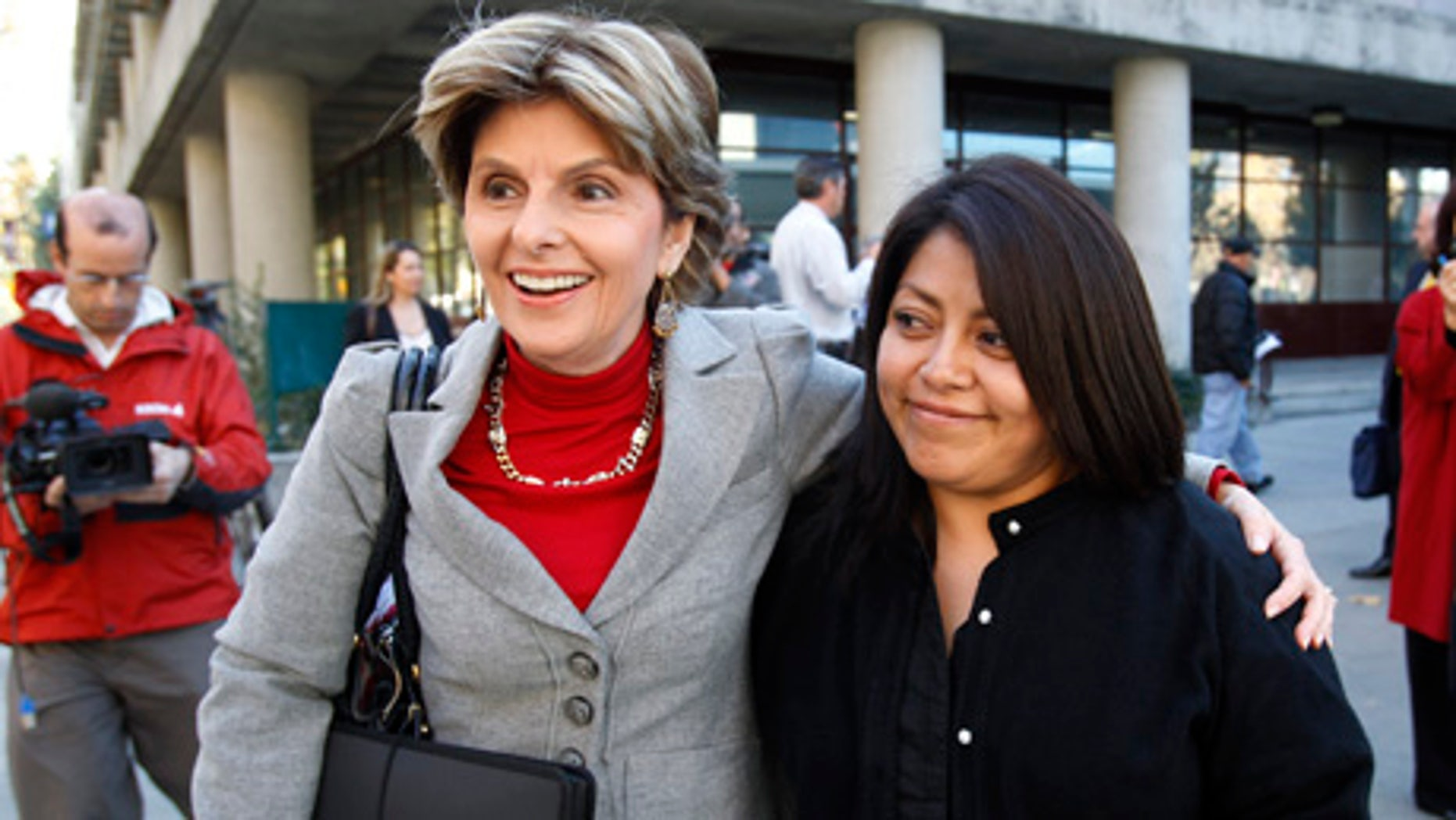 Nicky Diaz Santillan, right, and her attorney Gloria Allred, left, smile as they leave a hearing in San Jose, Calif., Wednesday, Nov. 17, 2010. Diaz Santillan, the illegal immigrant housekeeper who helped derail Meg Whitman's gubernatorial campaign, took her case before the California Department of Industrial Relations. She claims the former eBay CEO and billionaire owes her $6,210 in unpaid wages and mileage reimbursements accrued during the nine years she spent as the Whitman family's housekeeper. (AP Photo/Paul Sakuma)