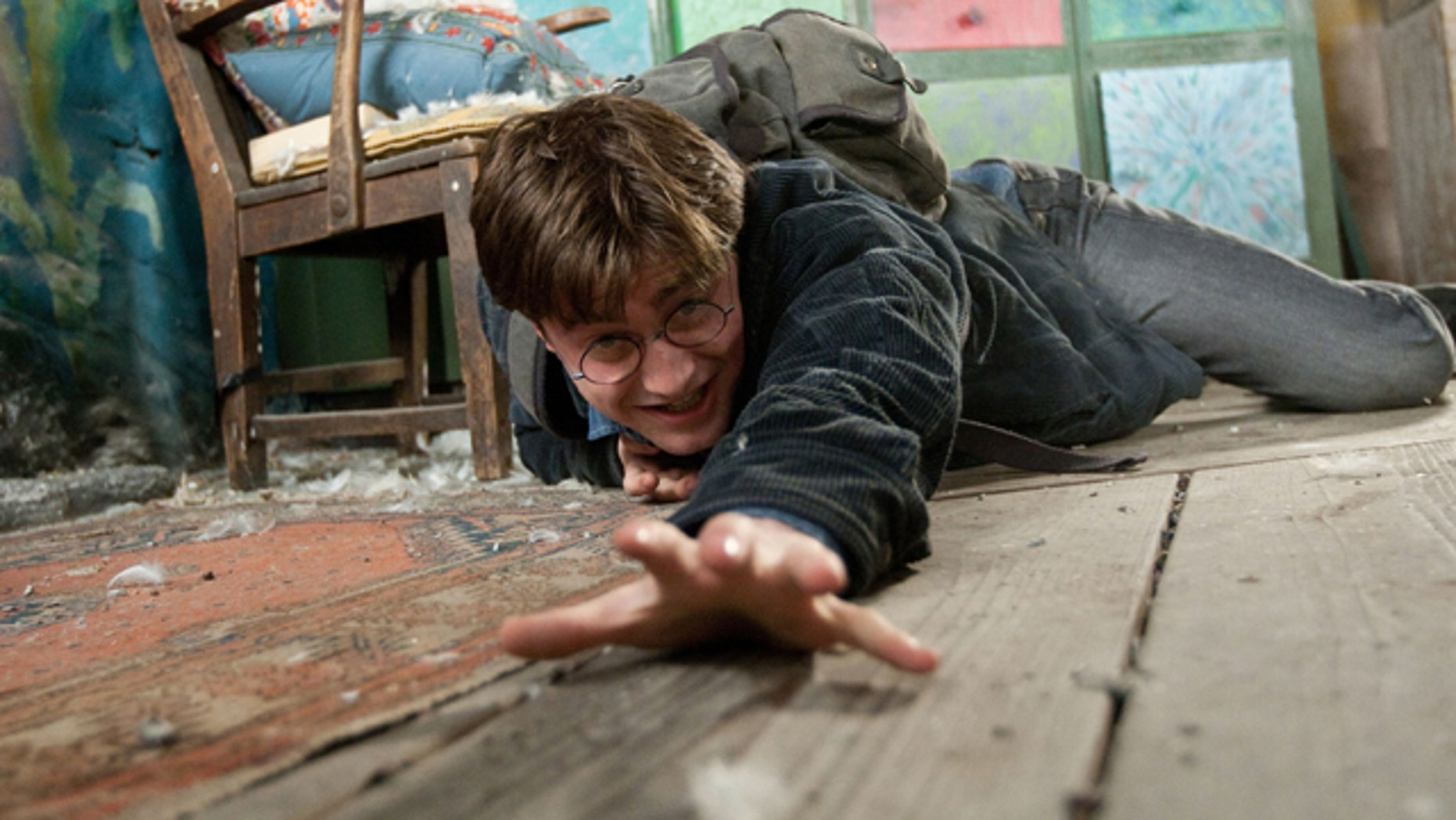 "In this film publicity image released by Warner Bros. Pictures, Daniel Radcliffe is shown in a scene from ""Harry Porter The Deathly Hallows: Part 1."""