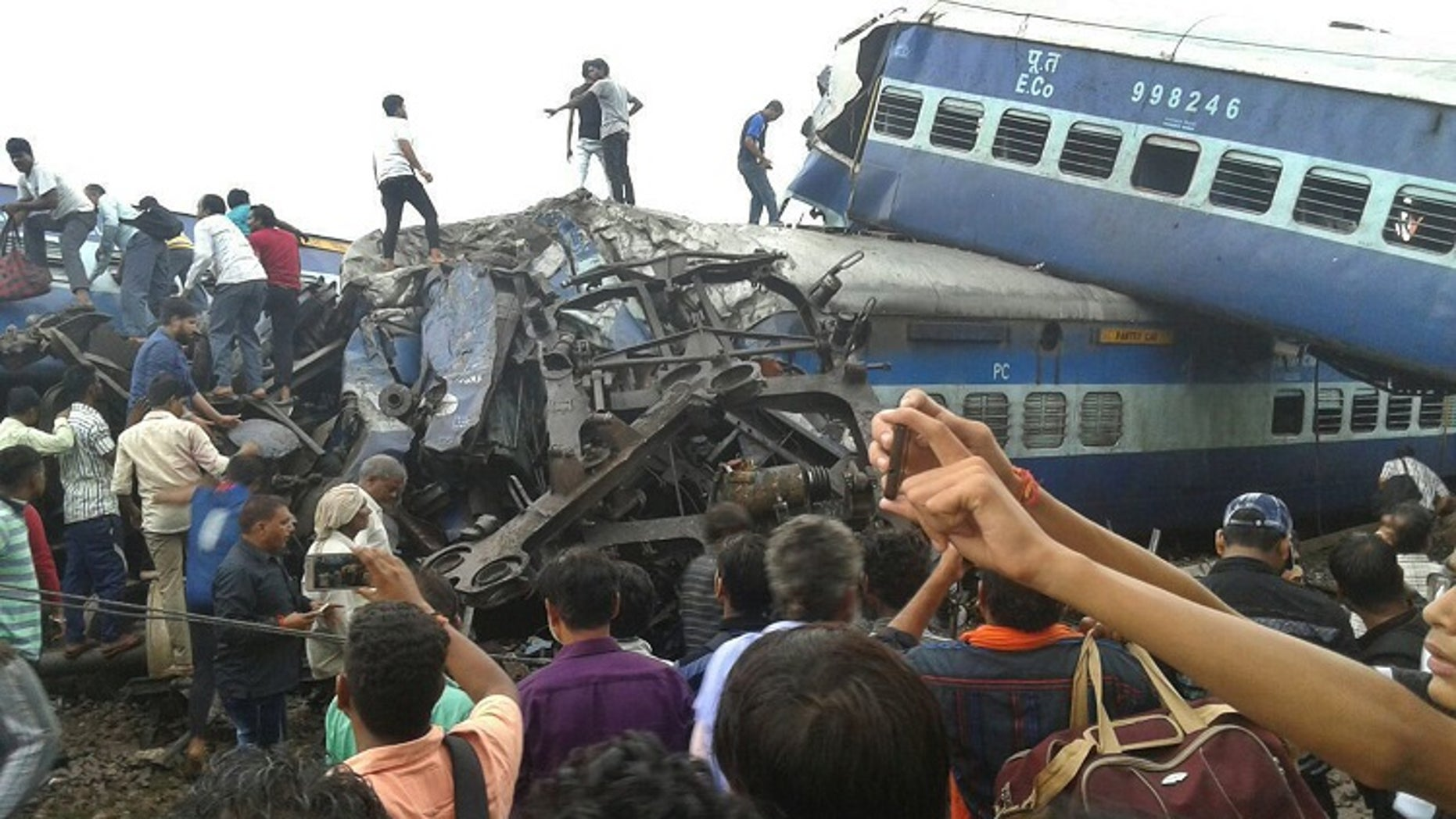 Six coaches of a passenger train derailed in northern India on Saturday, killing more than 20 people and injuring dozens, officials said.