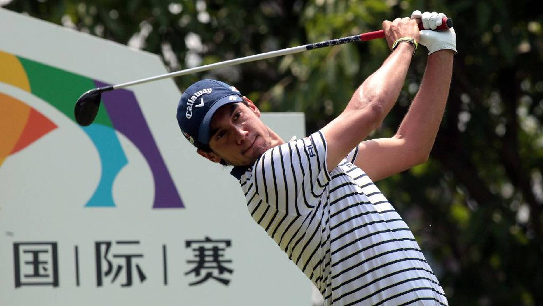 Matteo Manassero of Italy competes during the first round of the Shenzhen International golf tournament at Genzon Golf Club in Shenzhen in southern China's Guangdong Province, Thursday, April 16, 2015. (Chinatopix Via AP) CHINA OUT