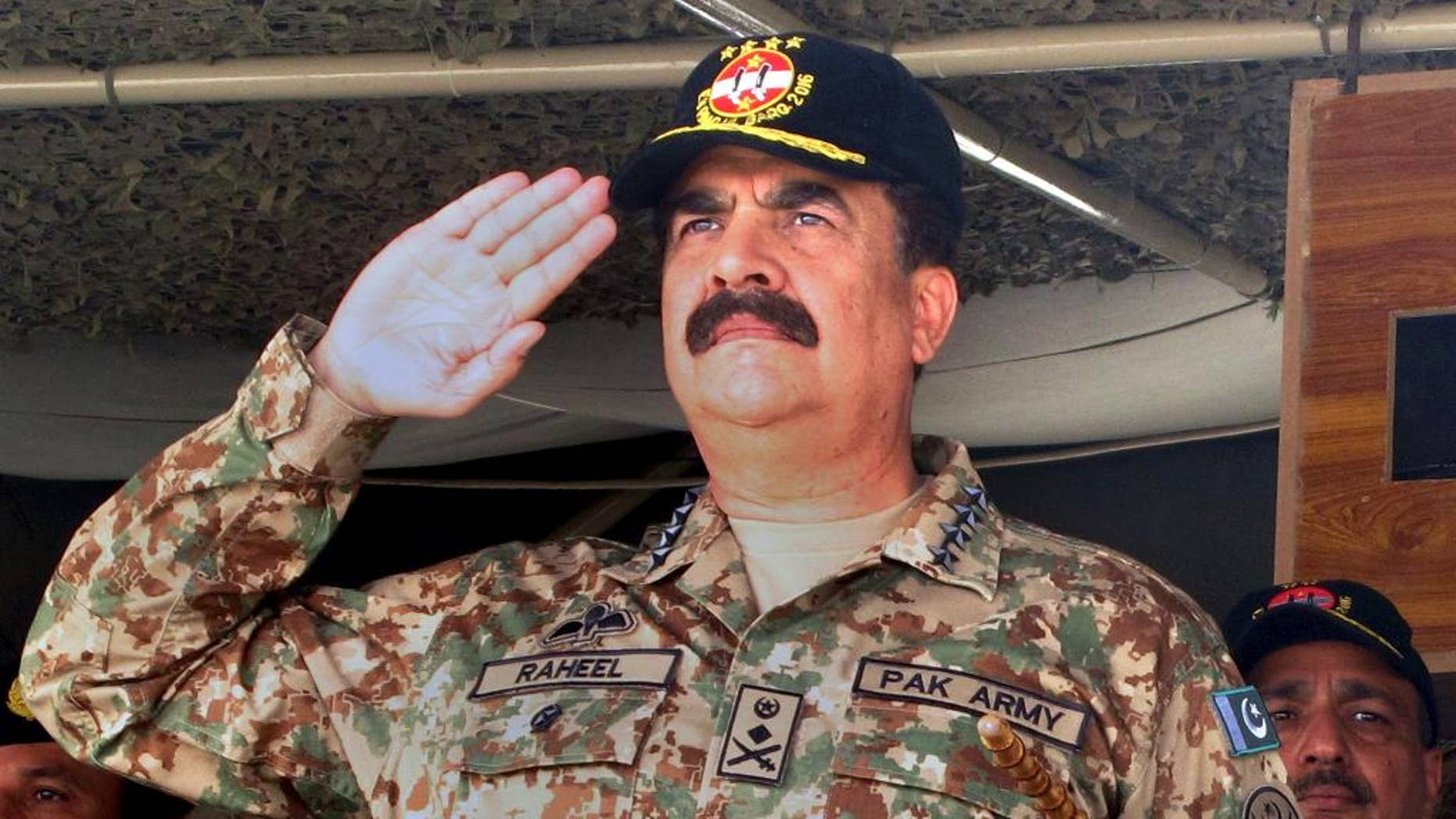 In this Wednesday, Nov. 16, 2016 photo, Pakistan army chief General. Raheel Sharif salutes during a military exercise in Khairpur Tamiwali, Pakistan. Pakistani army says on Monday, Nov. 21, 2016 its chief Sharif has started his farewell visits a week before his due retirement. Pakistani army's spokesman Lt. Gen. Asim Bajwa's Monday announcement has faded away debates about a possible extension in the three year term of the army chief, who is due to retire on Nov 29. (AP Photo/Muhammad Yousuf)