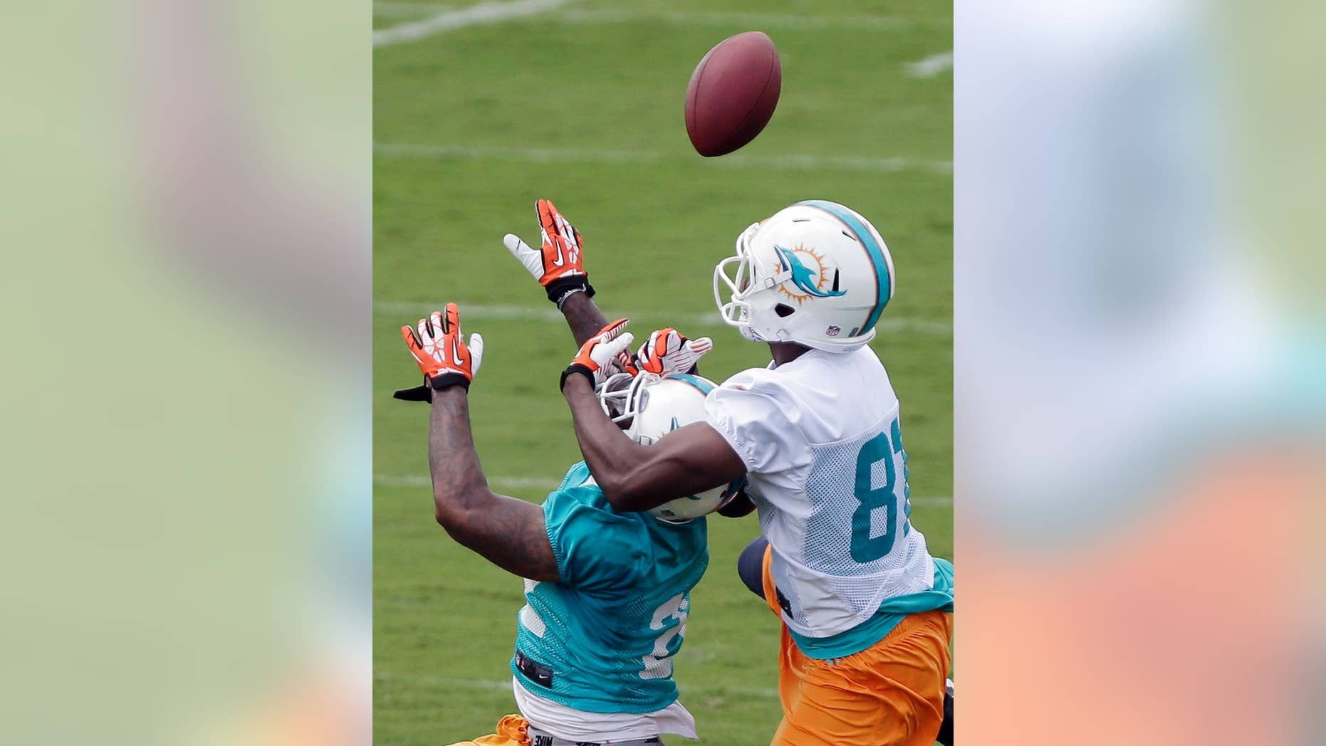 Miami Dolphins cornerback Jamar Taylor, left, breaks up a pass intended for wide receiver Stephen Williams during NFL football mini camp, Wednesday, June 18, 2014, in Davie, Fla. Taylor has pulled ahead of his teammate Will Davis by earning snaps opposite Pro Bowl cornerback Brent Grimes on the first-team defense. He appears to be fully recovered from the sports hernia injury that affected him as a rookie. (AP Photo/Wilfredo Lee)