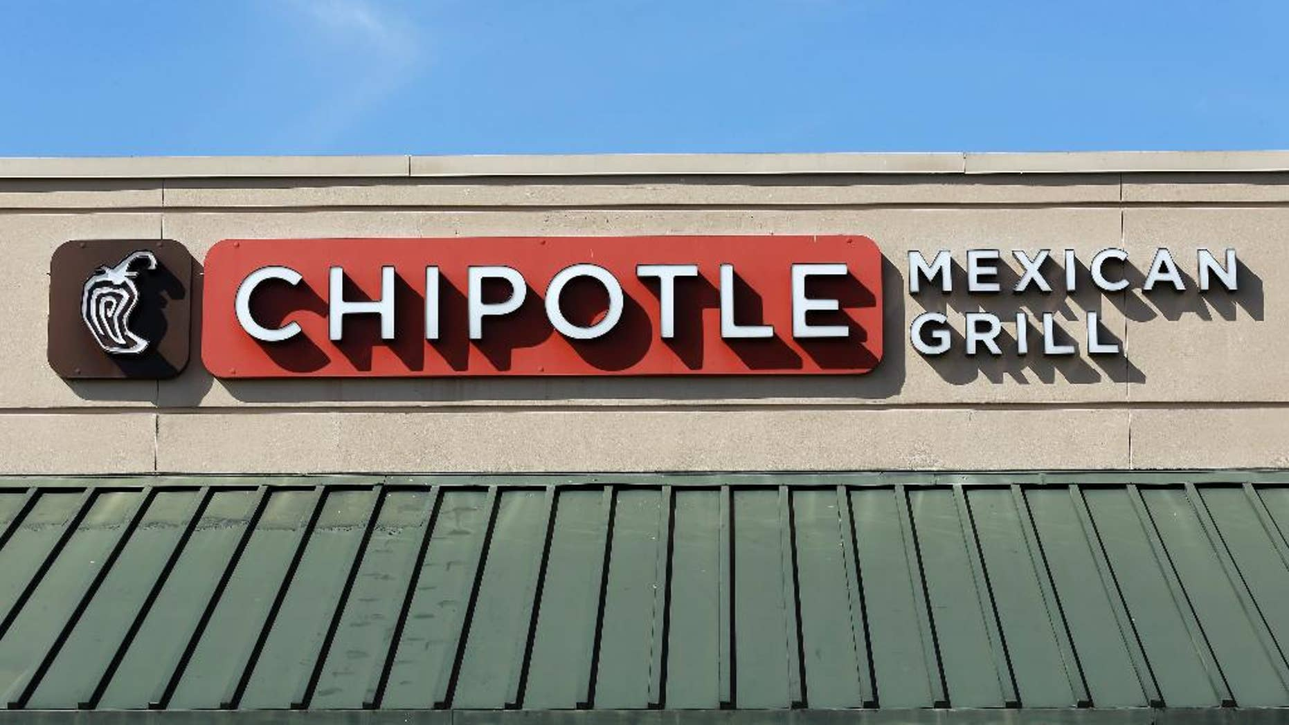 This Monday, Feb. 8, 2016, photo shows the sign over a Chipotle Mexican Grill in Brandon, Fla. The Chipotle marketing executive leading the chain's efforts to rebound after an E. coli outbreak was arrested Tuesday, July 5, 2016, on multiple counts of cocaine possession. (AP Photo/Chris O'Meara)