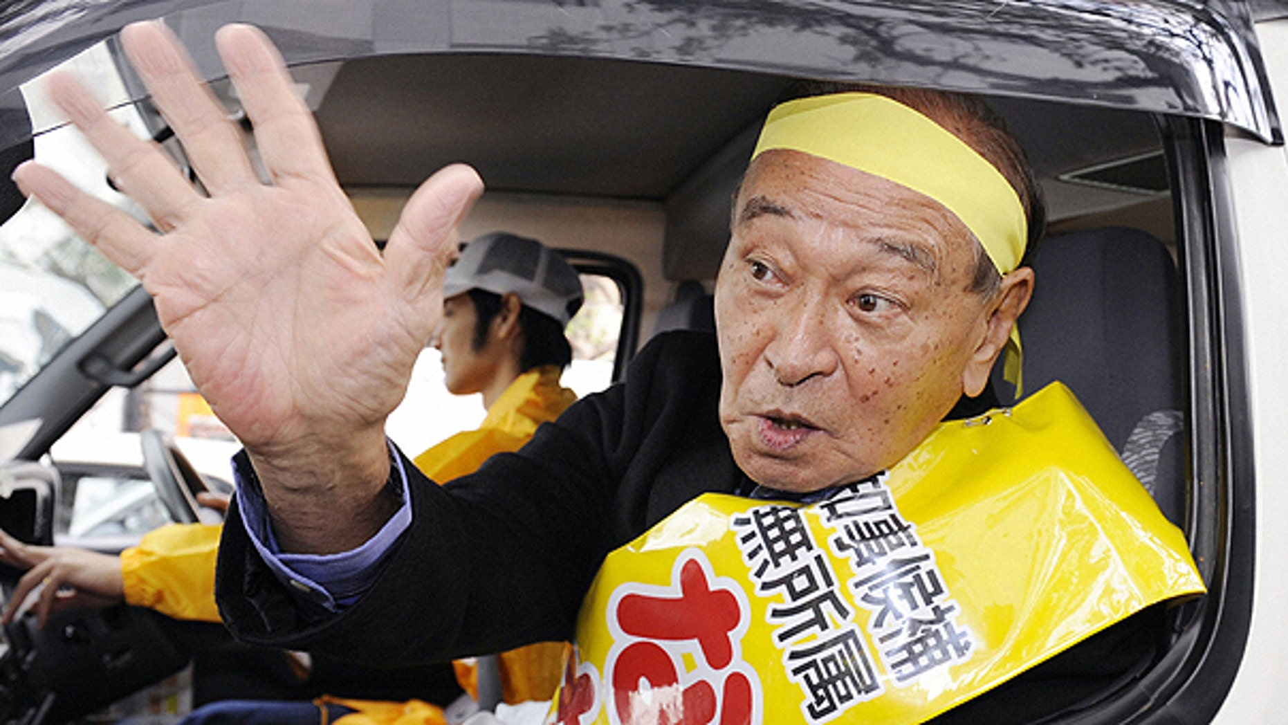 Nov. 11: Incumbent Okinawa Gov. Hirokazu Nakaima waves from a vehicle during his campaign for the Nov. 28 Okinawa gubernatorial election in Naha, Okinawa Prefecture, southern Japan.