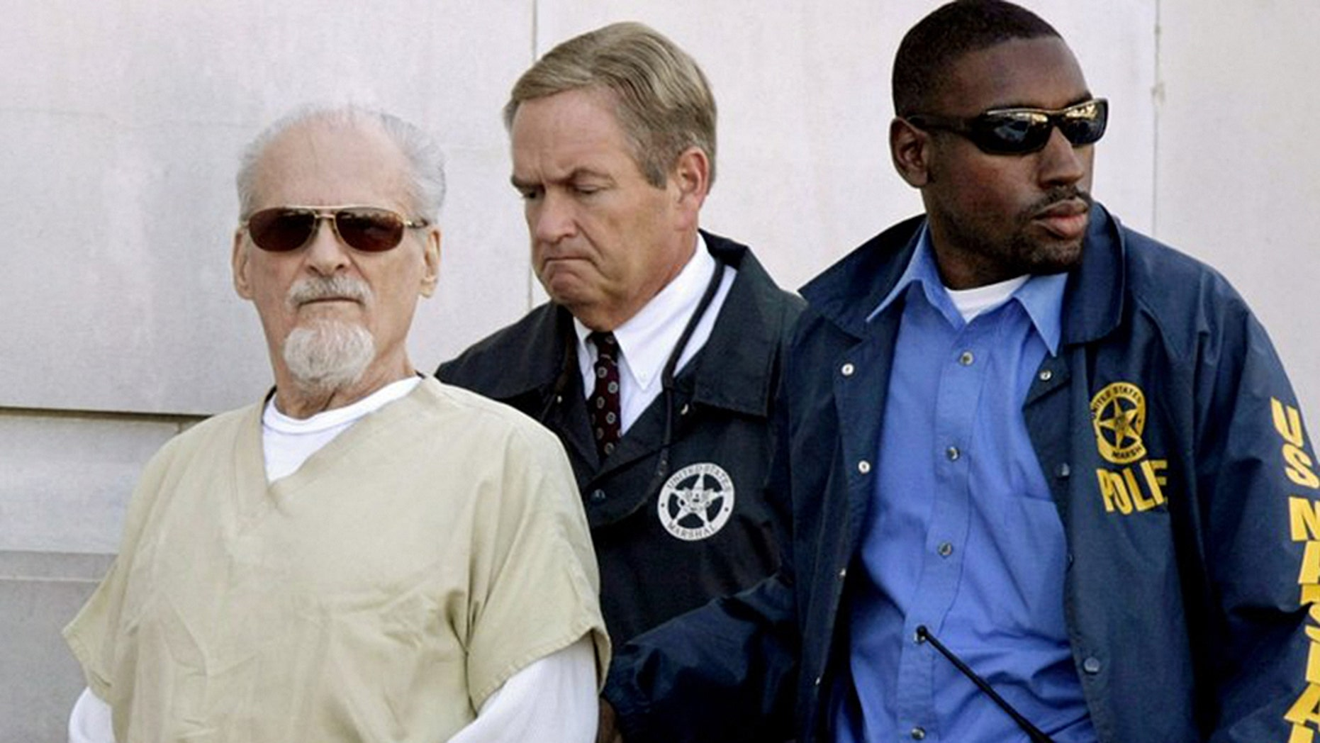 "Tony Alamo, left, is escorted from the Federal Court House in Texarkana, Ark., on July 23, 2009. His infamous case is the subject of a new special titled ""People Magazine Investigates: Cults"" on Investigation Discovery."
