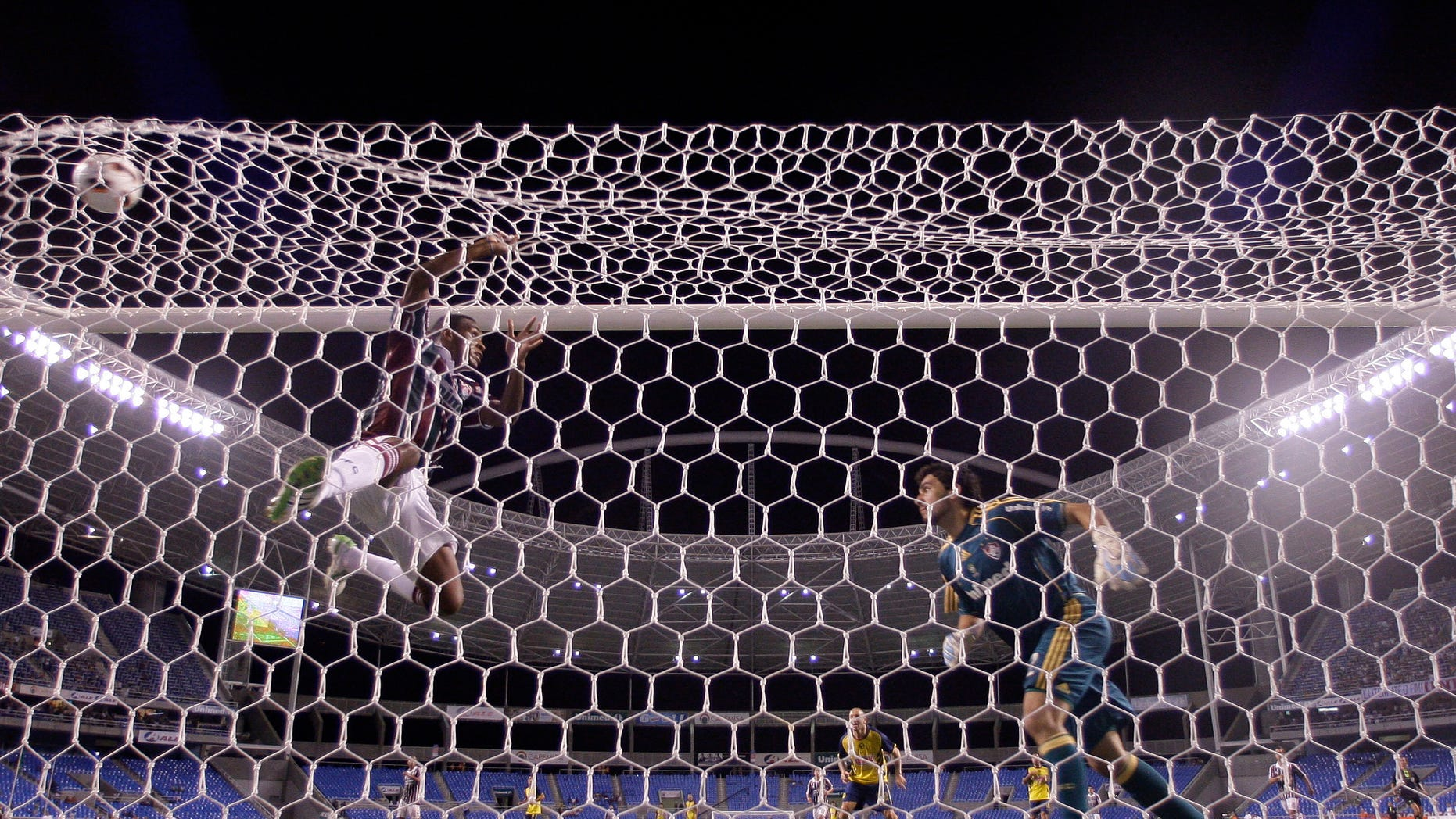 Brazil's Fluminense goalkeeper Ricardo Berna, right, and Digao, left, fail to stop a goal by Vicente Sanchez of Mexico's CF America during a Copa Libertadores soccer match in Rio de Janeiro, Brazil,  Wednesday, March 23, 2011. Brazil's Fluminense won the match 3-2. (AP Photo/Felipe Dana)