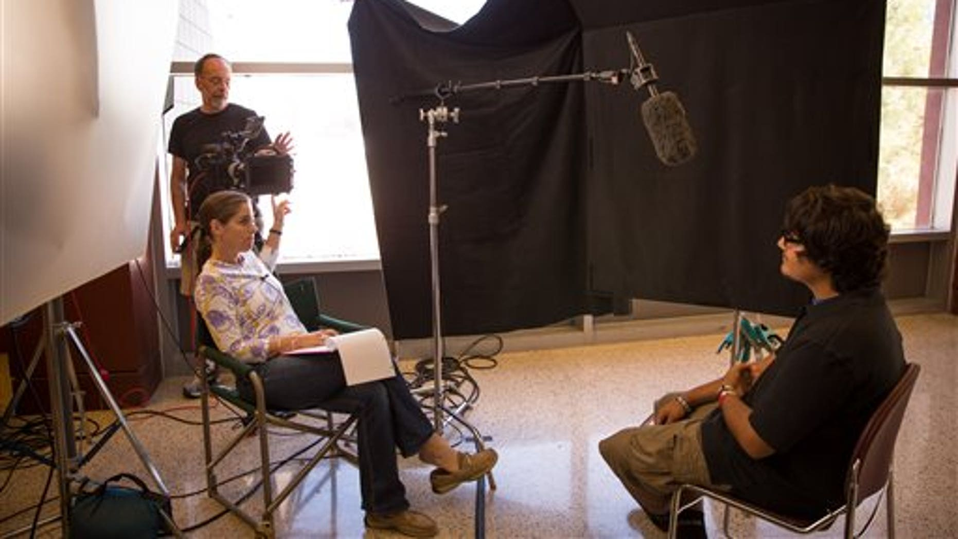 """Director Mary Mazzio and director of photography Richard Klug, left, during the filming of """"Underwater Dreams."""""""