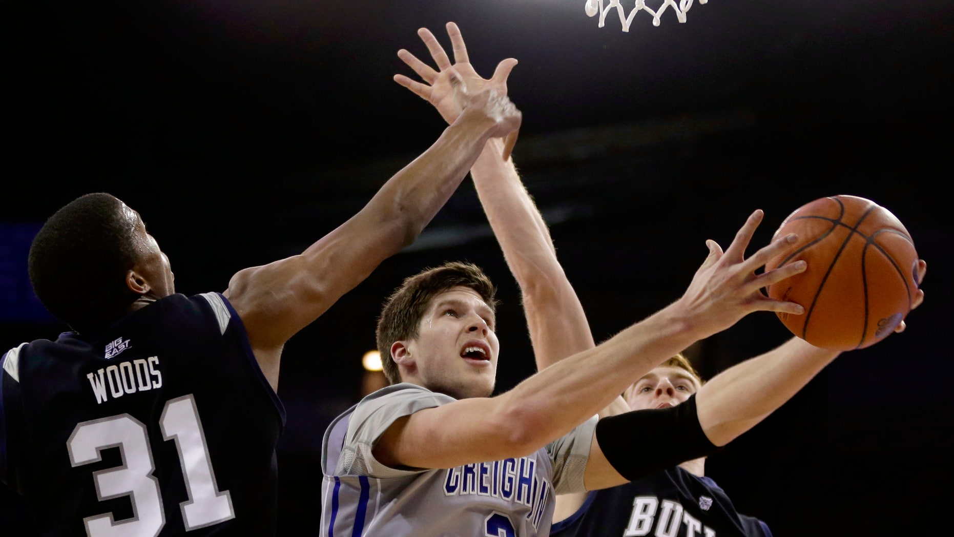 Creighton's Doug McDermott (3) goes for a layup against Butler's Kameron Woods (31) and Erik Fromm (4) in the second half of an NCAA college basketball game in Omaha, Neb., Tuesday, Jan. 14, 2014. Creighton won 88-60. (AP Photo/Nati Harnik)