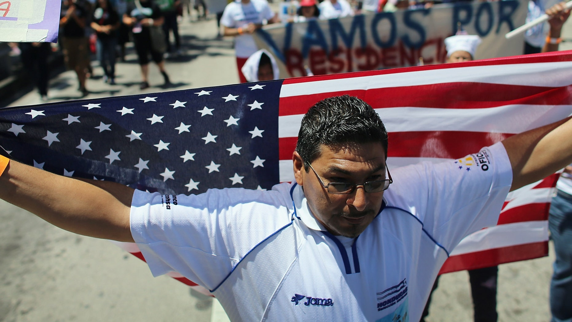 MIAMI, FL - APRIL 06: Julio Magana and others participate in a march that organizers said was an attempt to get the U.S. Congress to say yes to immigration reform on April 6, 2013 in Miami, Florida. The marchers were calling for a new immigration system with a real and inclusive path to citizenship for 11 million aspiring Americans, and to keep families together.  (Photo by Joe Raedle/Getty Images)
