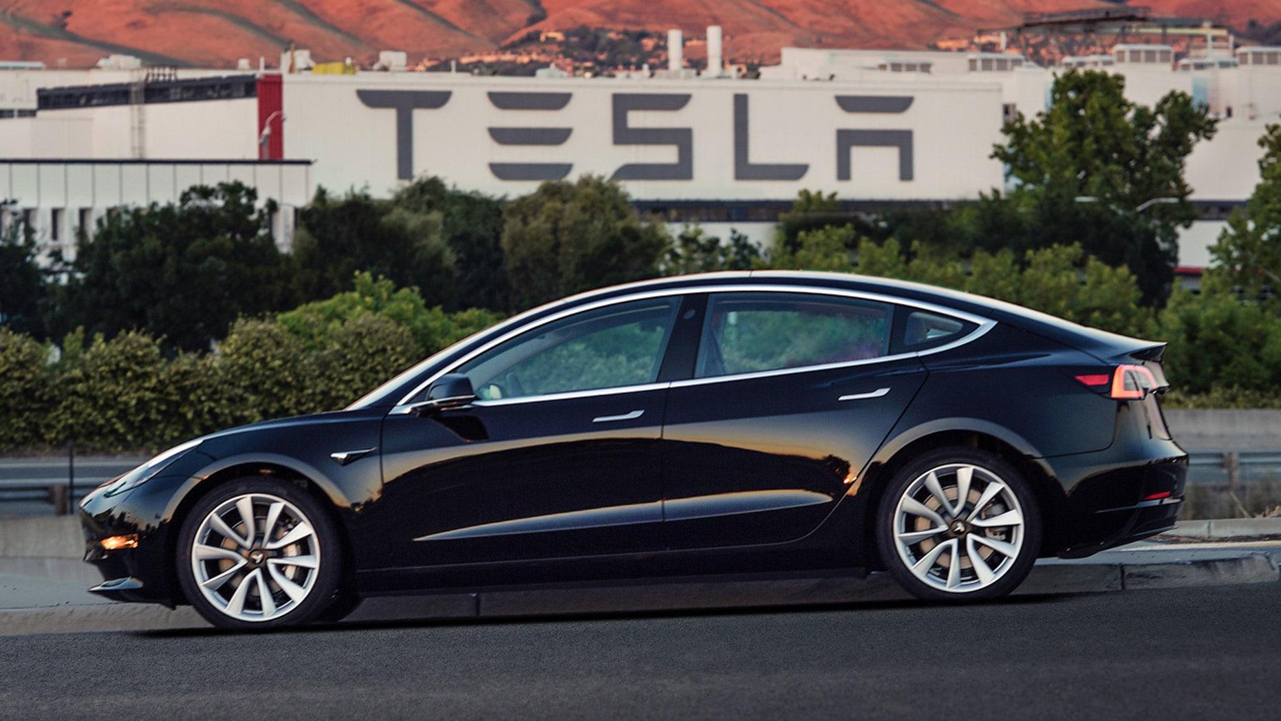 This undated image provided by Tesla Motors shows the Tesla Model 3 sedan.