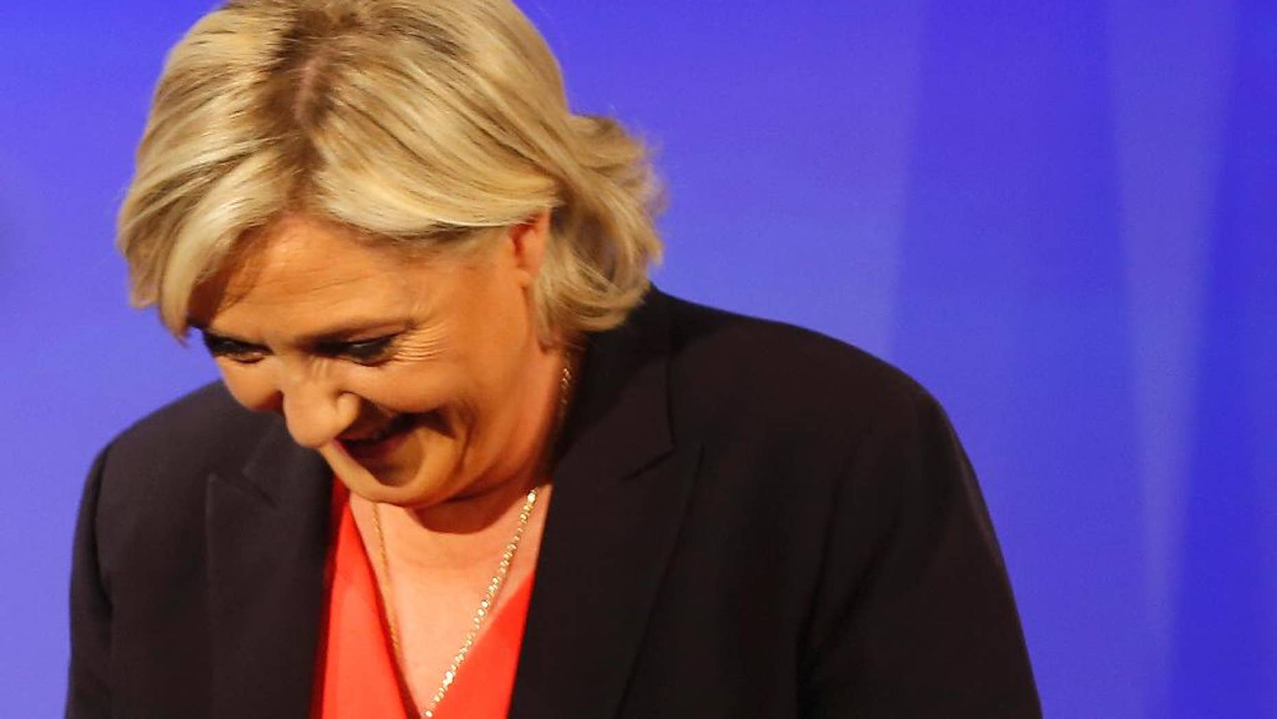 French far-right presidential candidate Marine Le Pen looks down after her speech at her election day headquarters Sunday, May 7, 2017 in Paris. Le Pen says she has called centrist Emmanuel Macron to congratulate him and says the vote confirms her National Front party and its allies as the leader of France's opposition. (AP Photo/Michel Euler)