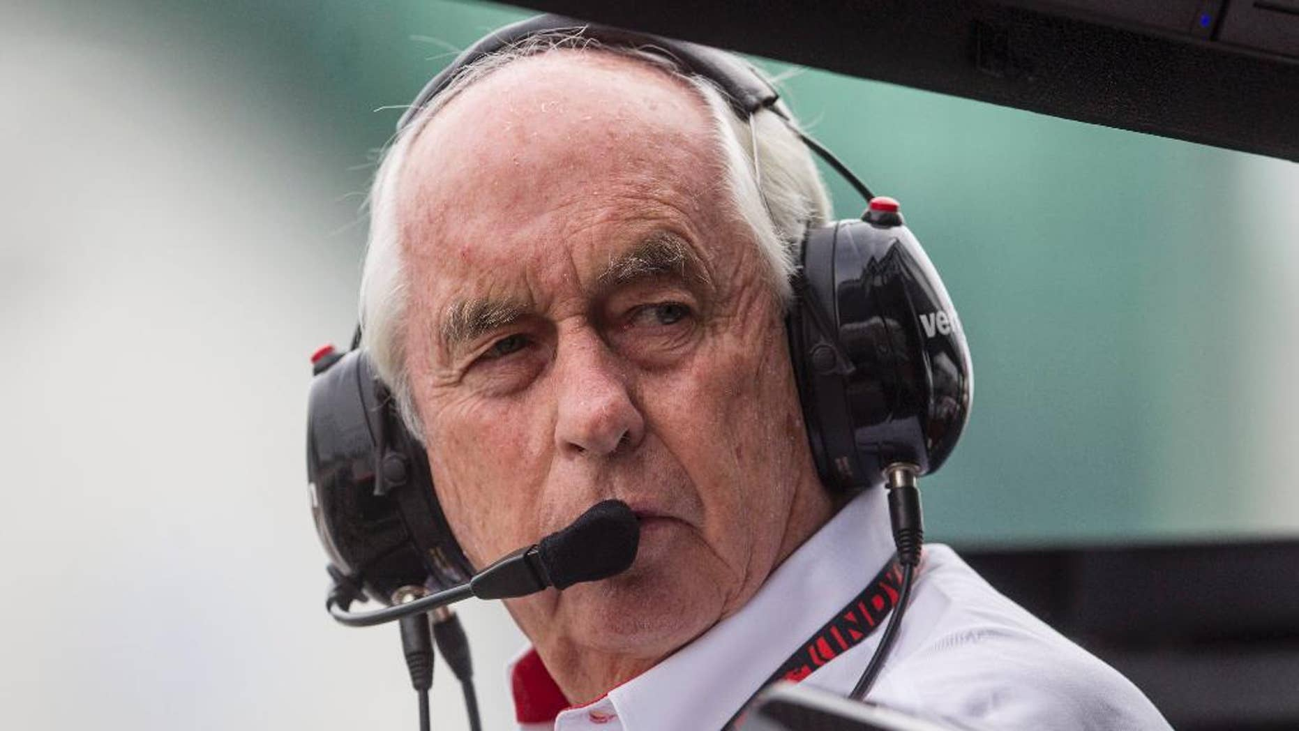 Roger Penske, owner of Team Penske, stands in the pits during a qualifying session for the IndyCar auto race in Toronto on Saturday, July 19, 2014.  (AP Photo/The Canadian Press, Chris Young)