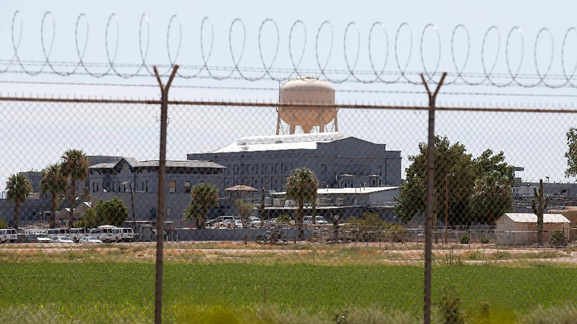 FILE - In this July 23, 2014, file photo, a fence surrounds the state prison in Florence, Ariz., where the execution of Joseph Rudolph Wood took place. (AP Photo/File)
