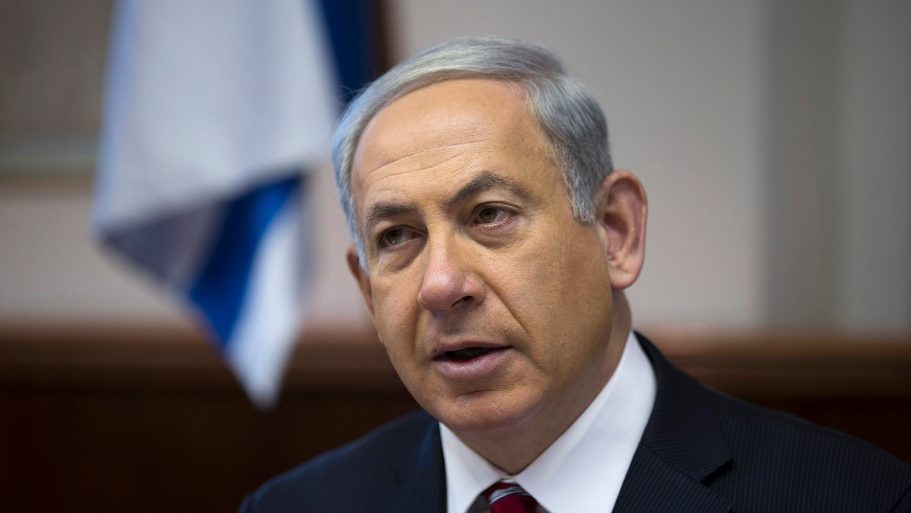 Israel's Prime Minister Benjamin Netanyahu attends the weekly cabinet meeting in Jerusalem on Sunday, Jan. 26, 2014. (AP Photos/Ronen Zvulun, Pool)