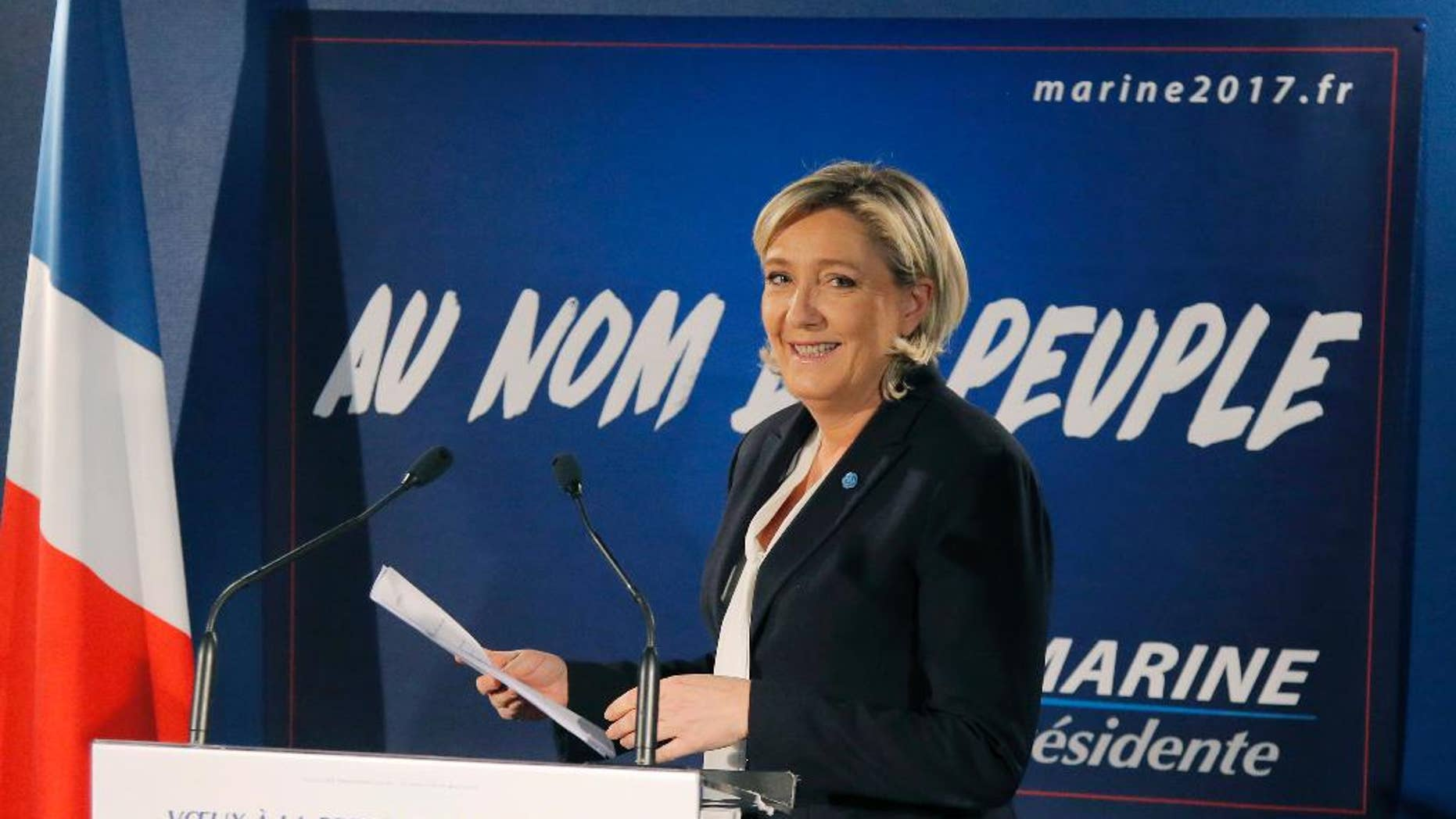 Far-right leader and candidate for next spring presidential elections Marine le Pen, arrives for her New Year's address to the media in Paris, Wednesday, Jan. 4, 2017. French far right presidential candidate Marine Le Pen is cheering Ford Motor Co.'s decision to shift investment from Mexico to the U.S., calling it a victory for the protectionist policies she champions. (AP Photo/Michel Euler)