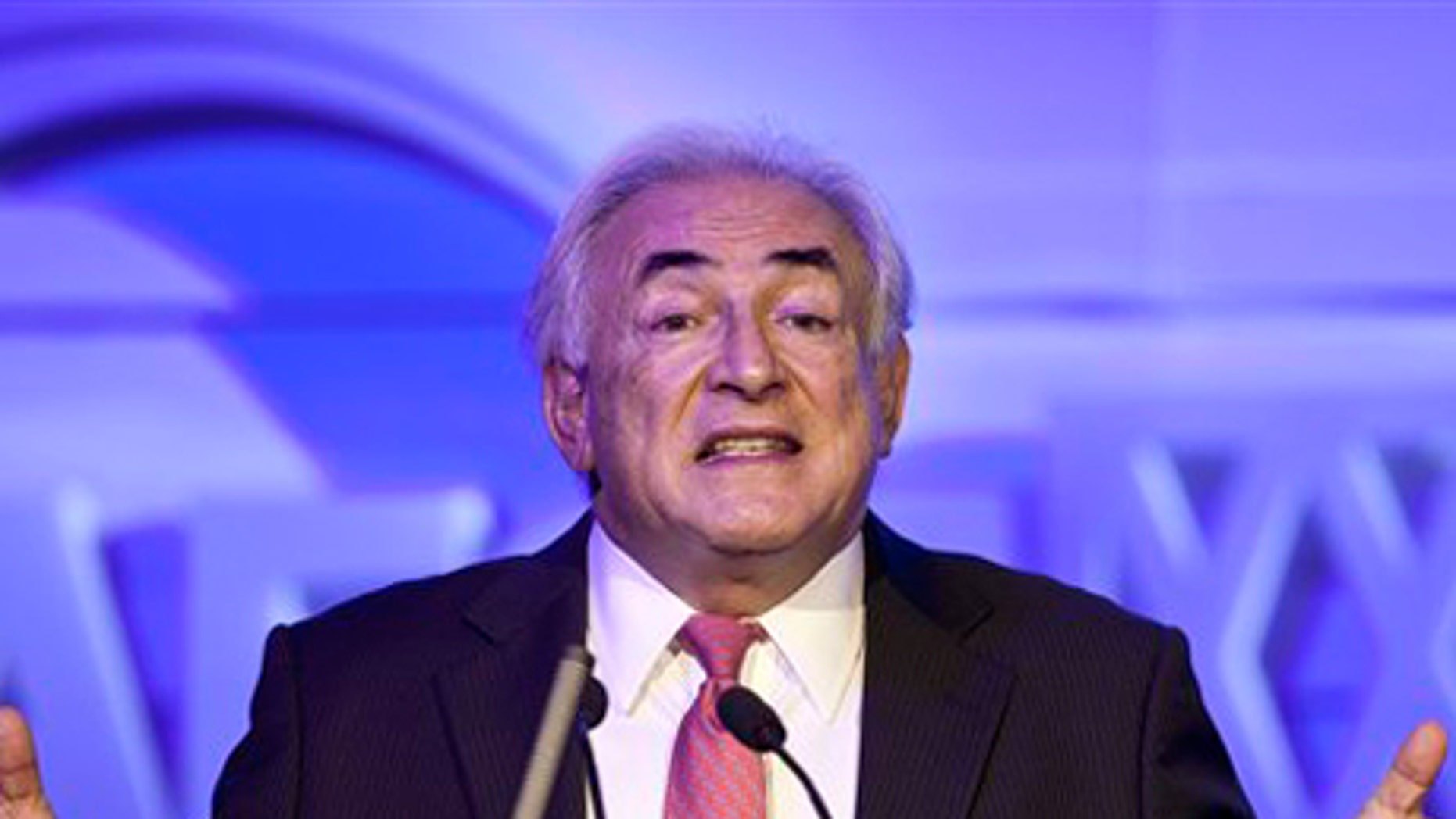 Dec. 19, 2011: Former IMF head Dominique Strauss-Kahn gestures as he speaks at an economy conference organized by Chinese Internet company Netease in Beijing, China.