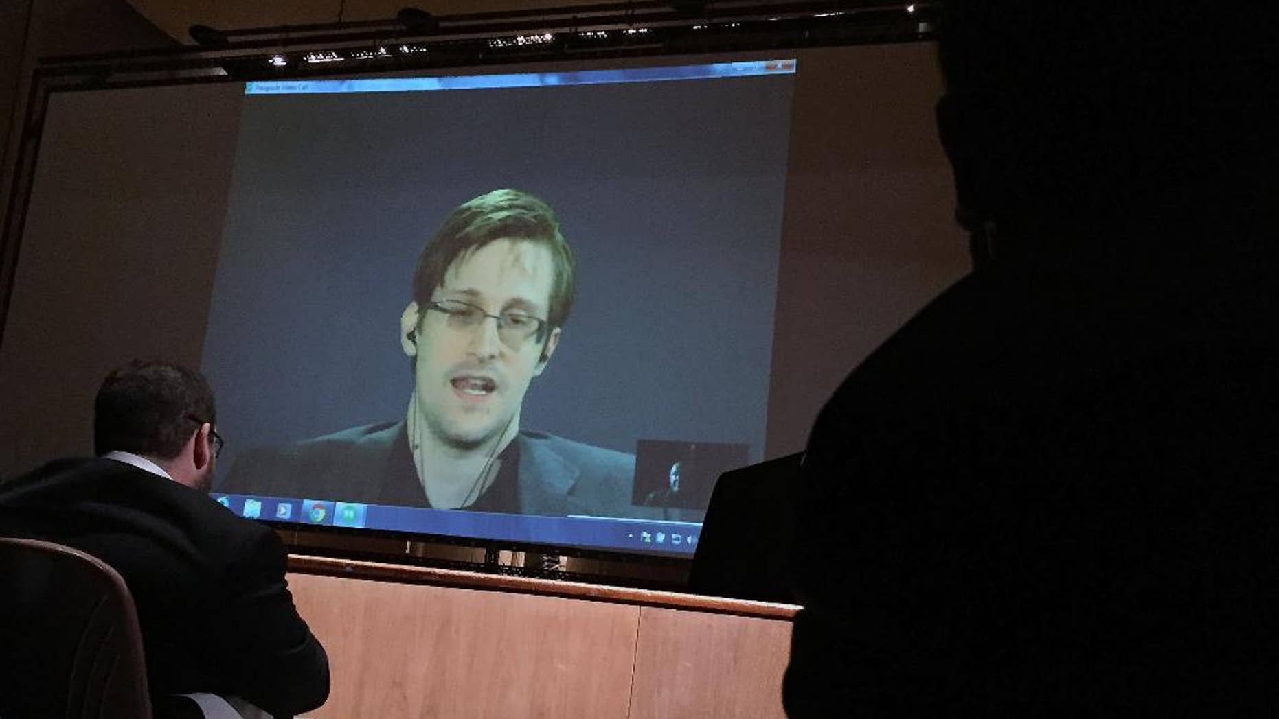 In this photo taken Feb. 17, 2016, former National Security Agency contractor Edward Snowden, center speaks via video conference to people in the Johns Hopkins University auditorium in Baltimore. The Senate on Wednesday, June 22, 2016, blocked an expansion of the government's power to investigate suspected terrorists, a victory for civil libertarians and privacy advocates emboldened after a National Security Agency contractor's revelations forced changes in how the communications of Americans are monitored.  (AP Photo/Juliet Linderman)