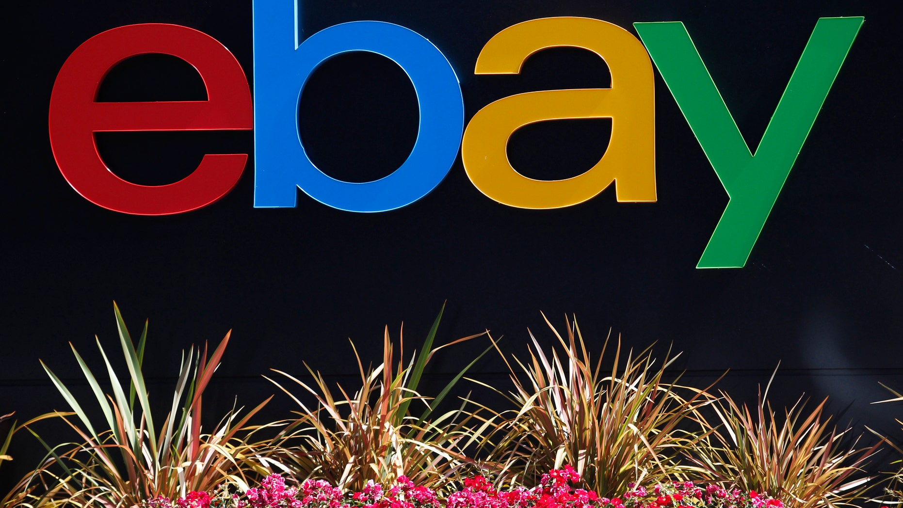 An eBay sign is seen at an office building in San Jose, California May 28, 2014. REUTERS/Beck Diefenbach (UNITED STATES - Tags: BUSINESS LOGO) - RTR3RALQ
