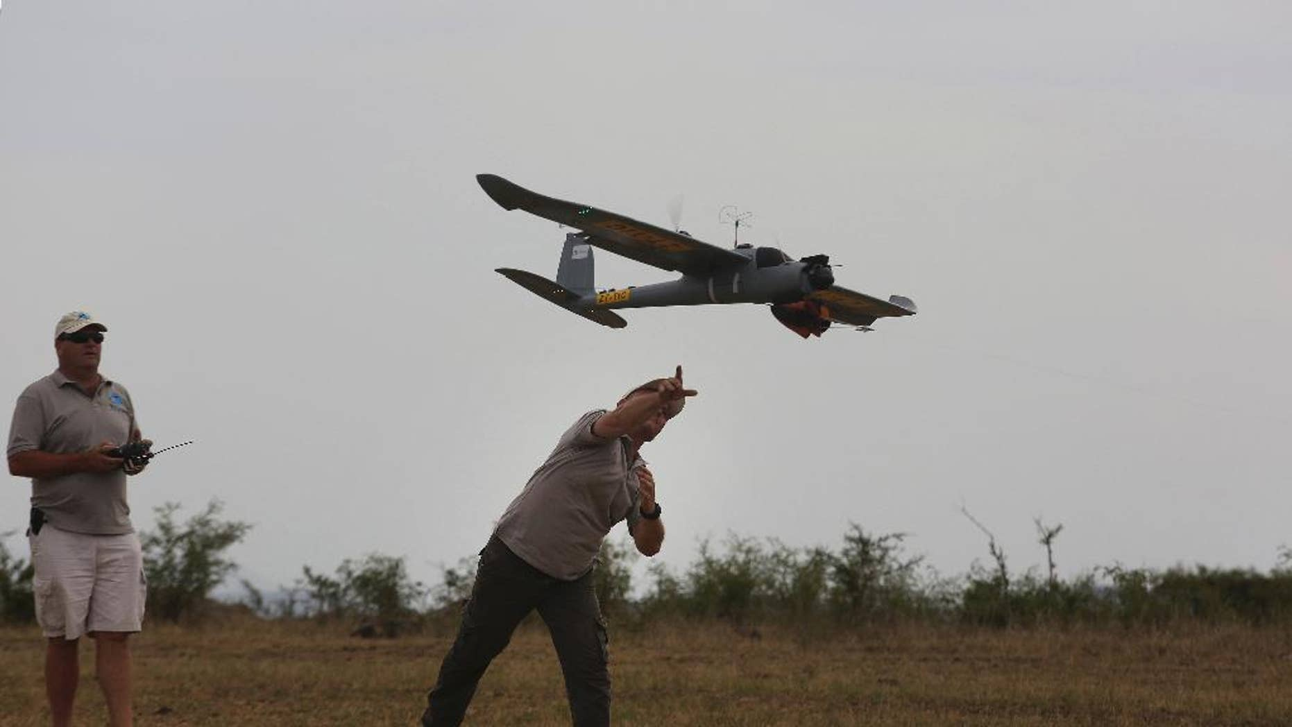 FILE -- In this file photo taken Monday, Feb. 15, 2016 a drone is launched in the Hluhluwe-iMfolozi Game Reserve in the KwaZulu Natal province. Conservationists say Zimbabwe and Malawi are allowing flights by anti-poaching drones as part of an initiative supported by Google and the WWF conservation group. (AP Photo/Denis Farrell, File)