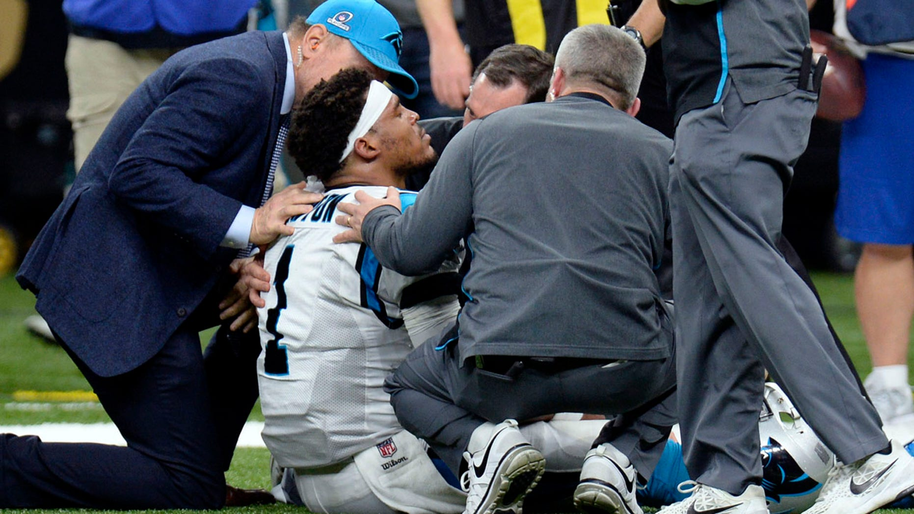 Jan. 7: Cam Newton is tended to by medical personnel after being sacked in the second half against the New Orleans Saints in New Orleans