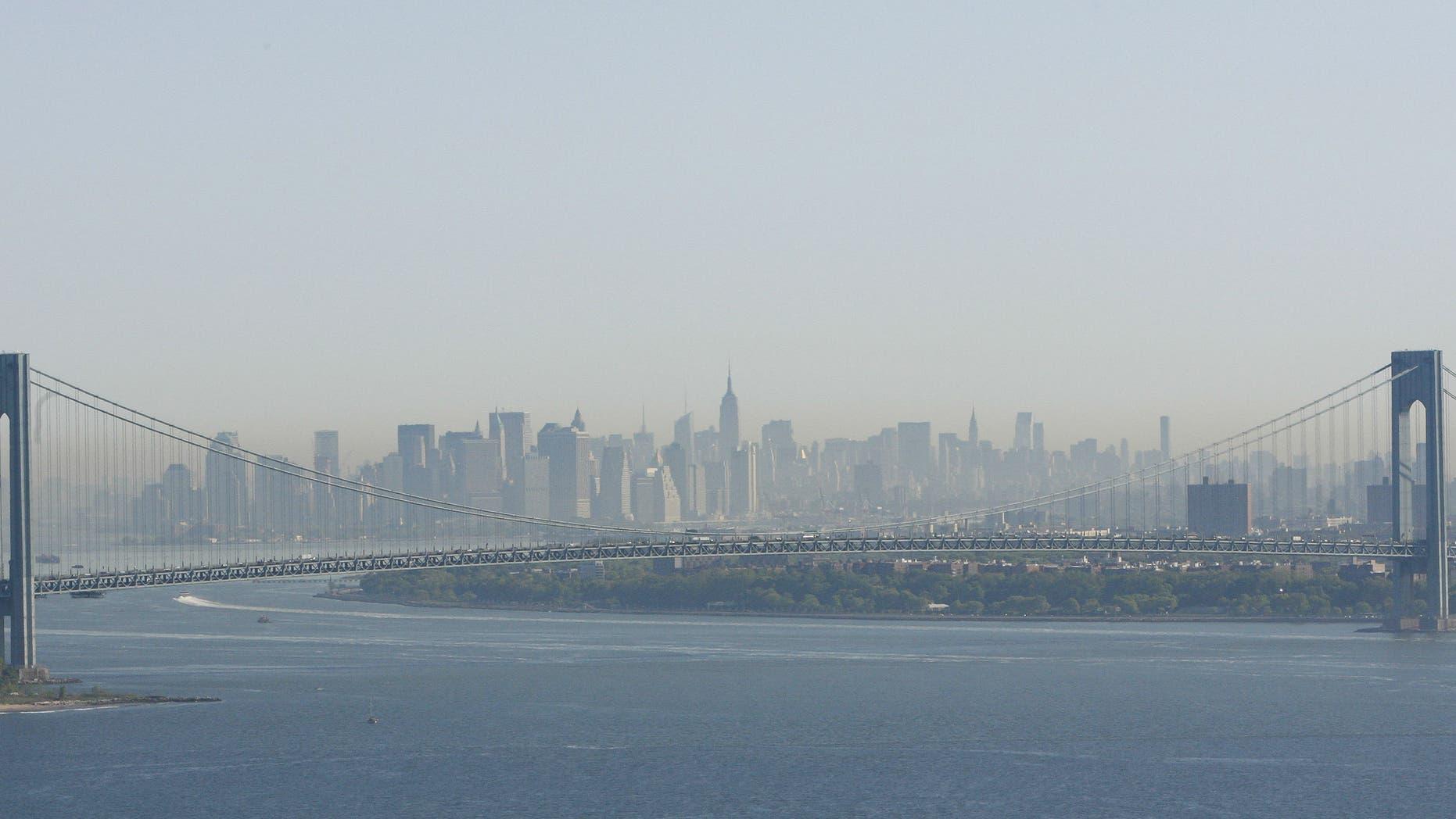 A layer of smog can be seen above Manhattan through the Verrazano-Narrows Bridge in New York.