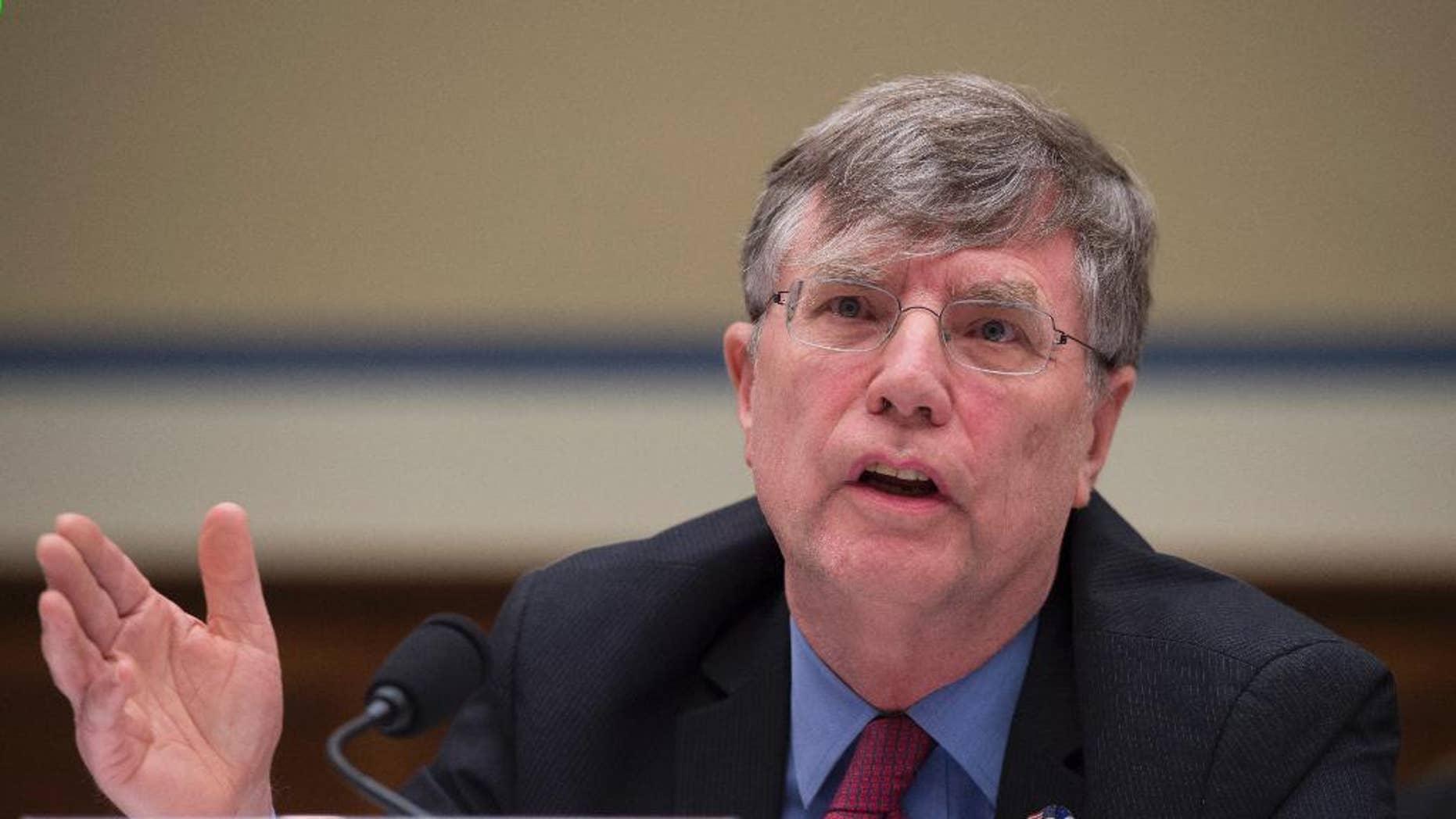 """FILE - In this Sept. 8, 2016 file photo, Undersecretary of State for Management Patrick Kennedy testifies on Capitol Hill in Washington. Kennedy  sought last year for the FBI to change the classification level of an email from Hillary Clinton's private server in a proposed bargain described as a """"quid pro quo"""" that would have allowed the FBI to deploy more agents in foreign countries, according to internal FBI records released Monday, Oct. 17, 2016. (AP Photo/Molly Riley, File)"""