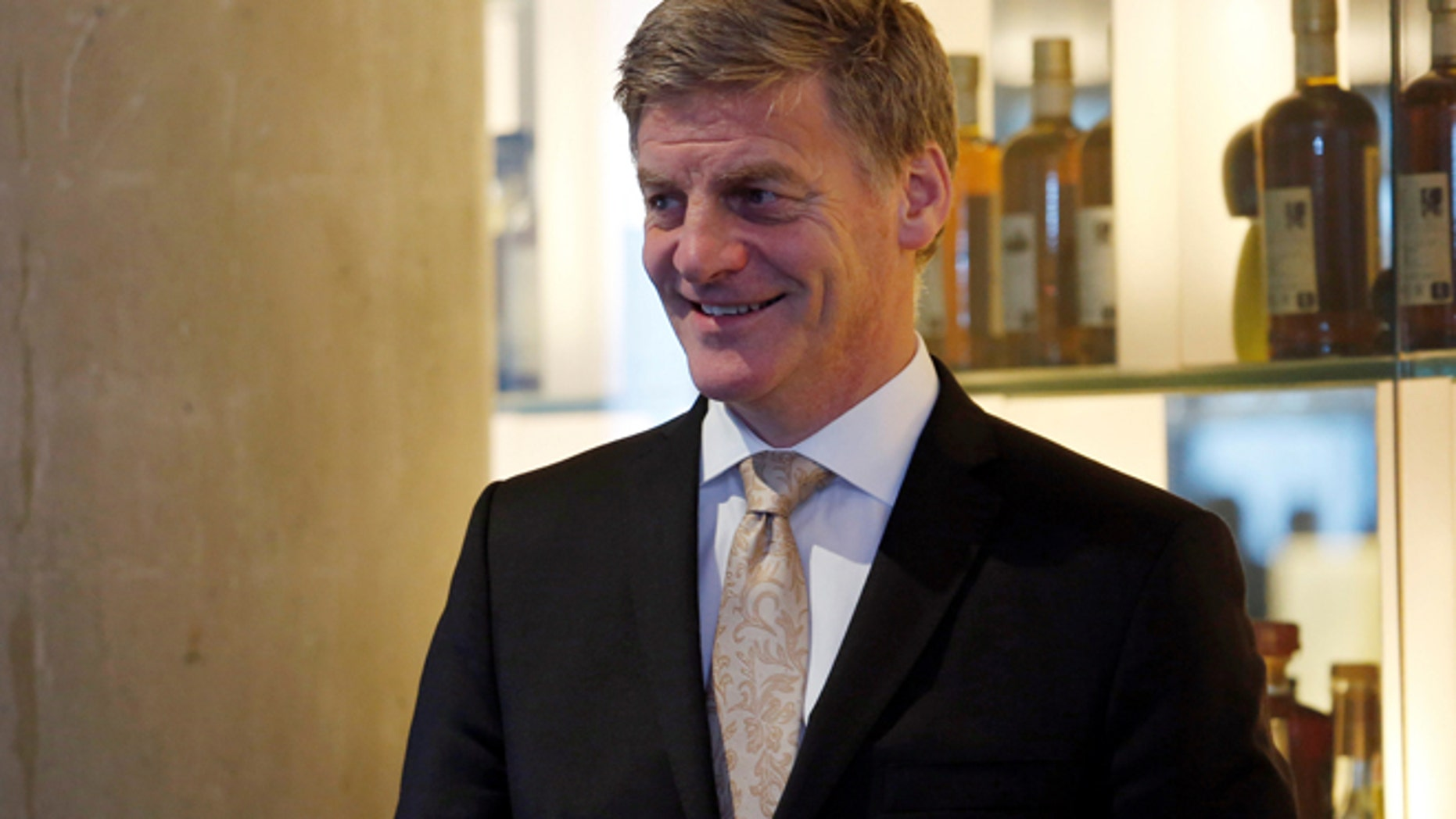 FILE: New Zealand Prime Minister Bill English attends an event to promote a New Zealand lamb product at a restaurant in Hong Kong