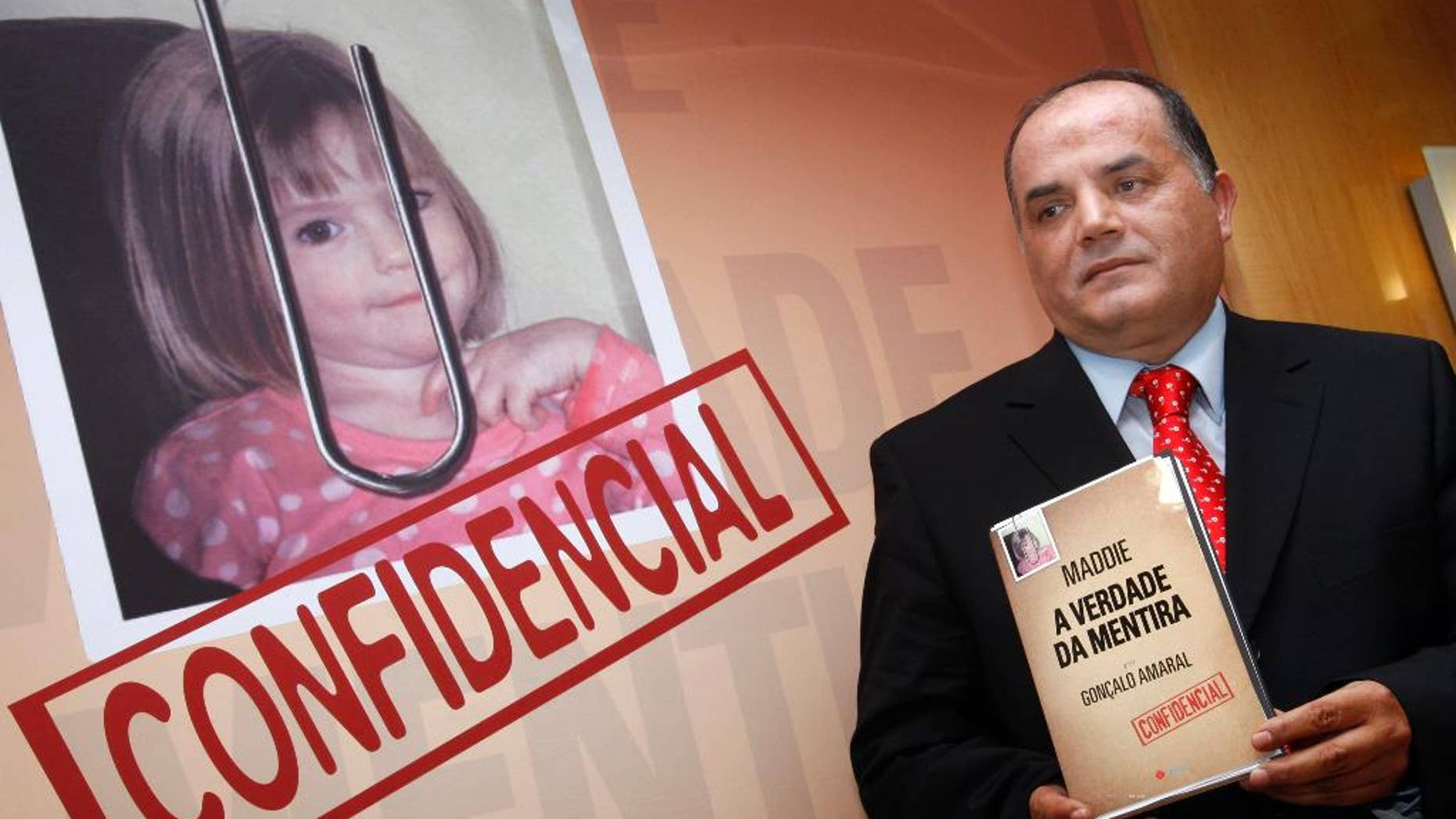 """FILE - In this July 24, 2008 file photo, former detective Goncalo Amaral poses with his book whose title translates as """"The Truth in the Lies"""", during its launch in Lisbon. Portugal's Supreme Court has ruled that missing British girl Madeleine McCann's parents can't sue for libel a former Portuguese detective who published a book alleging they were involved in their daughter's disappearance. A court official told The Associated Press on Tuesday, Jan. 31, 2017 that Portugal's highest court ruled the allegations are protected by freedom of expression laws and weren't abusive. (AP Photo/Joao Henriques, file)"""
