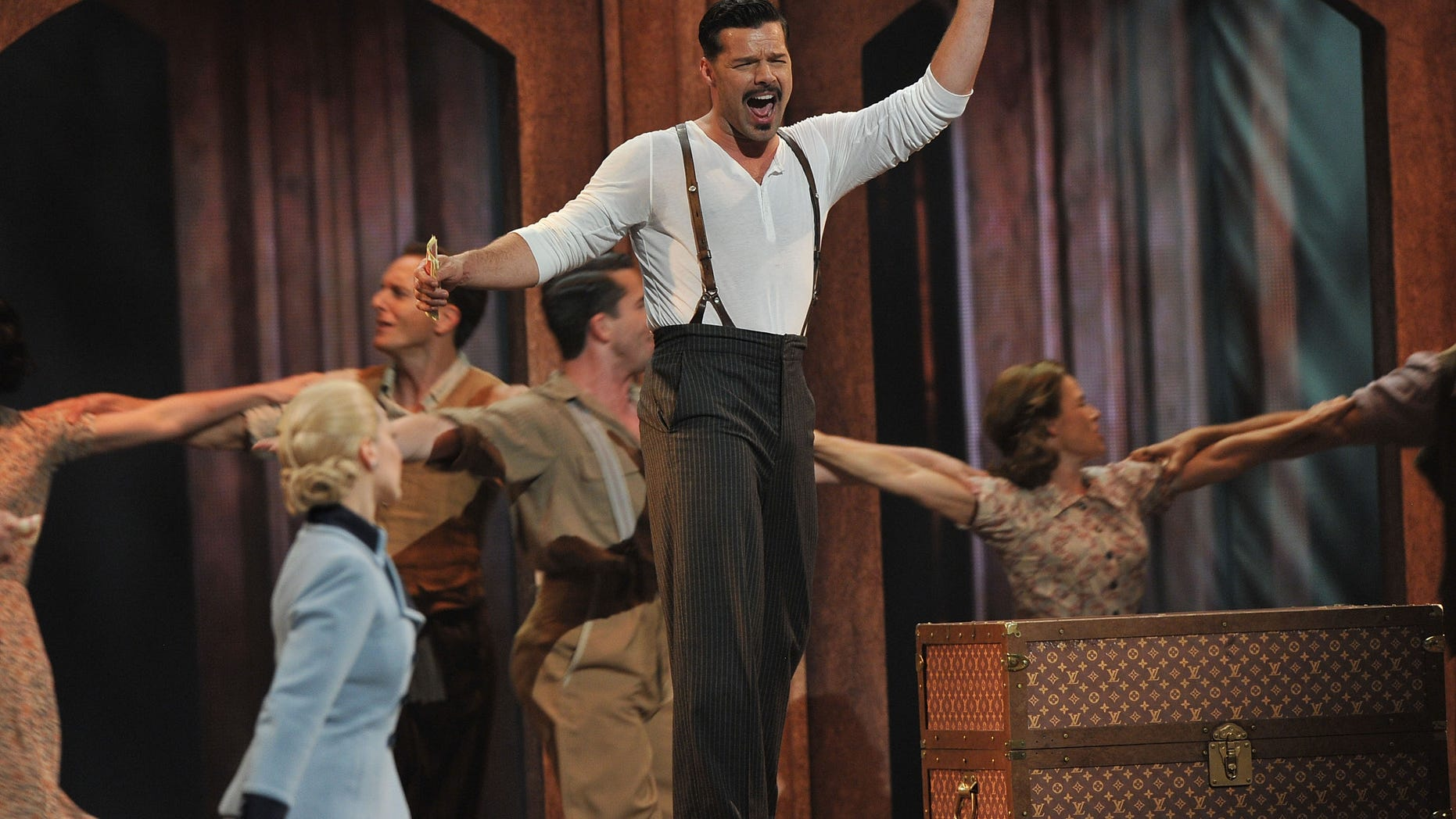"""NEW YORK, NY - JUNE 10:  Ricky Martin and Elena Roger of """"Evita"""" perform onstage at the 66th Annual Tony Awards at The Beacon Theatre on June 10, 2012 in New York City.  (Photo by Theo Wargo/Getty Images)"""