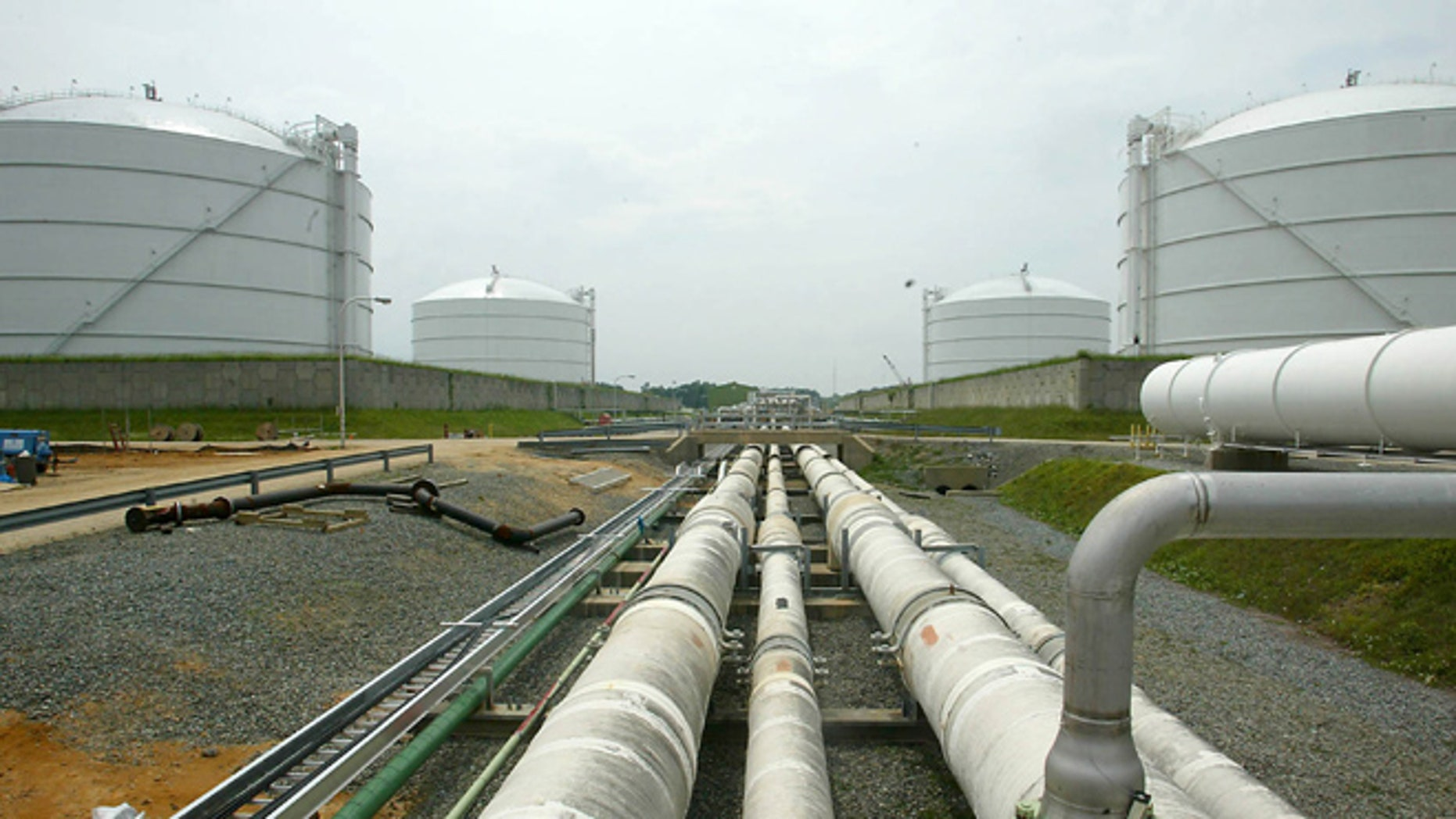 June 13, 2003: This file photo shows pipelines running from the offshore docking station to four liquefied natural gas (LNG) tanks at the Dominion Resources Inc. Liquefied Natural Gas facility in Cove Point, Md. (AP/Matt Houston, File)