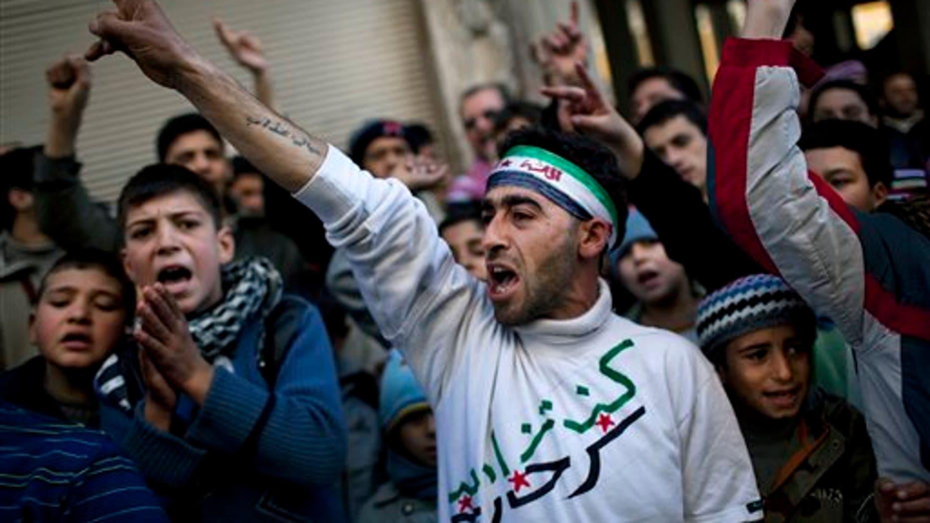Feb. 24: People chant slogans against Syrian President Bashar Al-Assad's regime during a demonstration in Kafar Taharim, northern  Syria.
