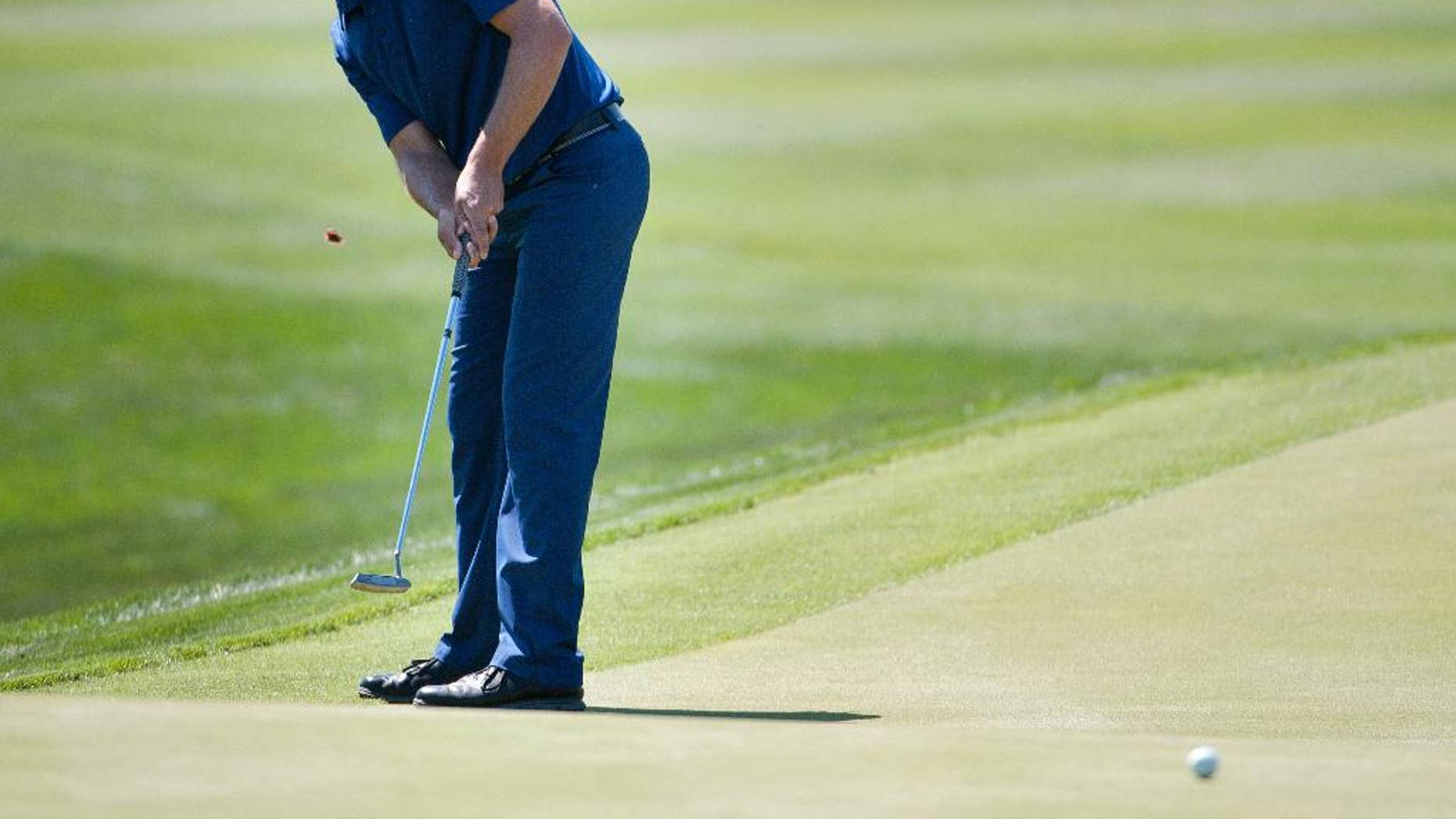 Aaron Baddeley, of Australia, putts on the ninth green during the second round of the Valero Texas Open golf tournament, Friday, March 27, 2015, in San Antonio. (AP Photo/Darren Abate)