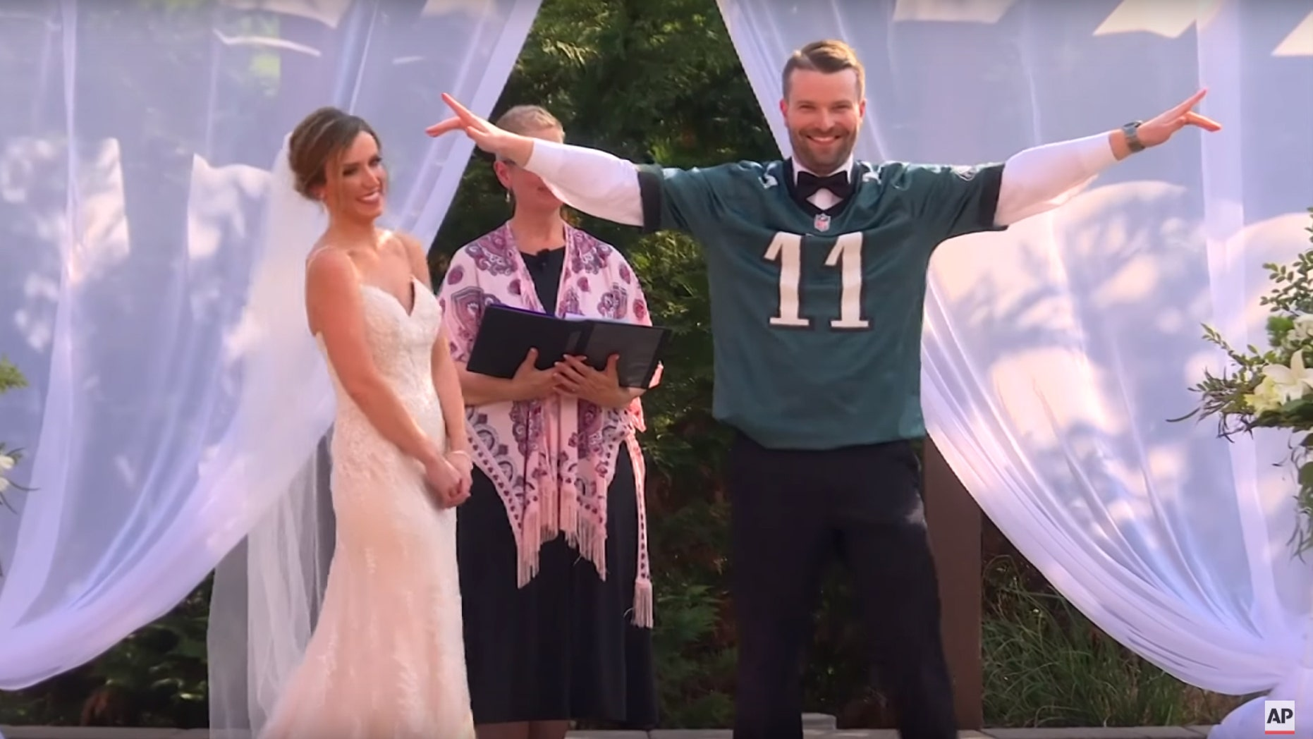 Jennifer Sullivan, in a gorgeous white gown, and Patrick Hanks, in Carson Wentz jersey, tied the knot over Memorial Day weekend.