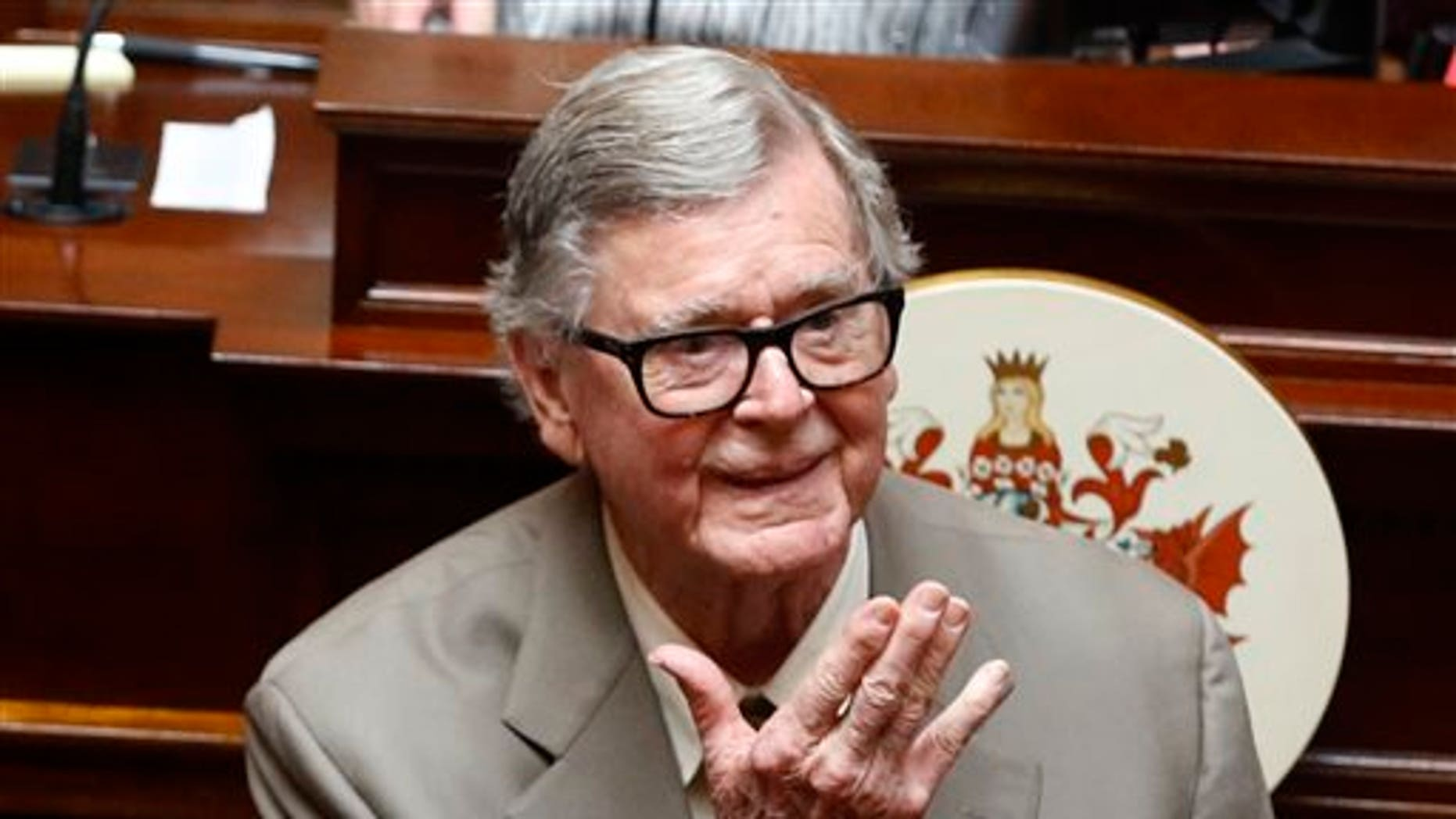 In this Wednesday, April 3, 2013 file photo, author Earl Hamner Jr. blows a kiss to relatives in the gallery as he is honored by the Virginia Senate at the state capitol in Richmond, Va. Hamner died on March 24, 2016. (AP Photo/Richmond Times-Dispatch, Bob Brown)
