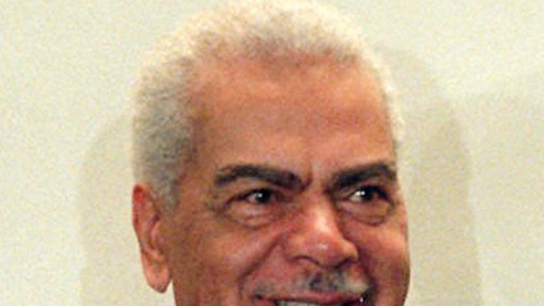 """FILE - In this Feb. 3, 1997, file photo, Earle Hyman poses before an induction to the Theater Hall of Fame at the Gershwin Theatre in New York. Hyman, a veteran actor of stage and screen who was widely known for playing Russell Huxtable on """"The Cosby Show,"""" has died. Strohl, a representative for The Actors Fund, says that Hyman died Friday, Nov. 17, 2017, at the Lillian Booth Actors Home in Englewood, New Jersey. He was 91. (AP Photo/Ron Frehm, File)"""