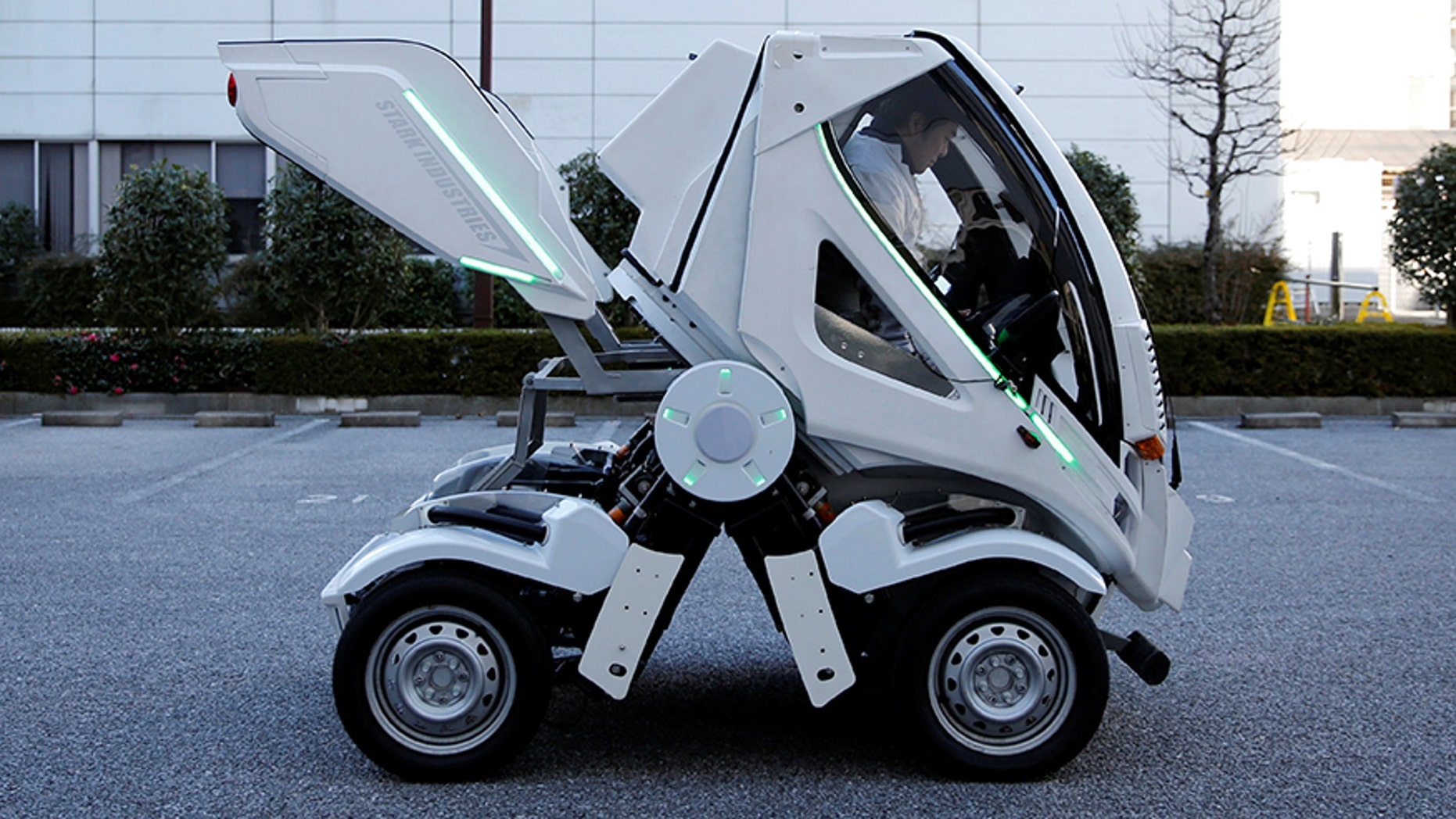 """Four Link Systems, Inc's fully electric foldable vehicle 'Earth-1' which was designed by Kunio Okawara, famous in Japan as the artist behind the long-running wildly popular robot anime """"Gundam"""", changes its form in Tokyo, Japan December 27, 2017. Picture taken December 27, 2017. REUTERS/Toru Hanai - RC149EA13170"""
