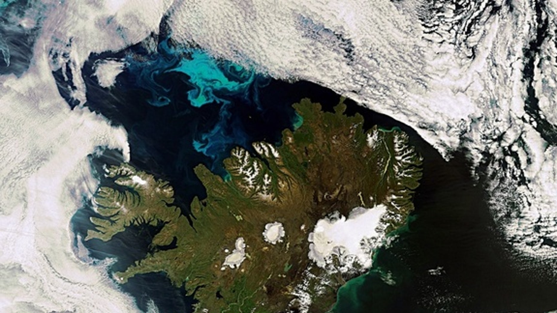 This Envisat image shows us a very rare, cloud-free view of Iceland. This image was acquired on July 21, 2010.