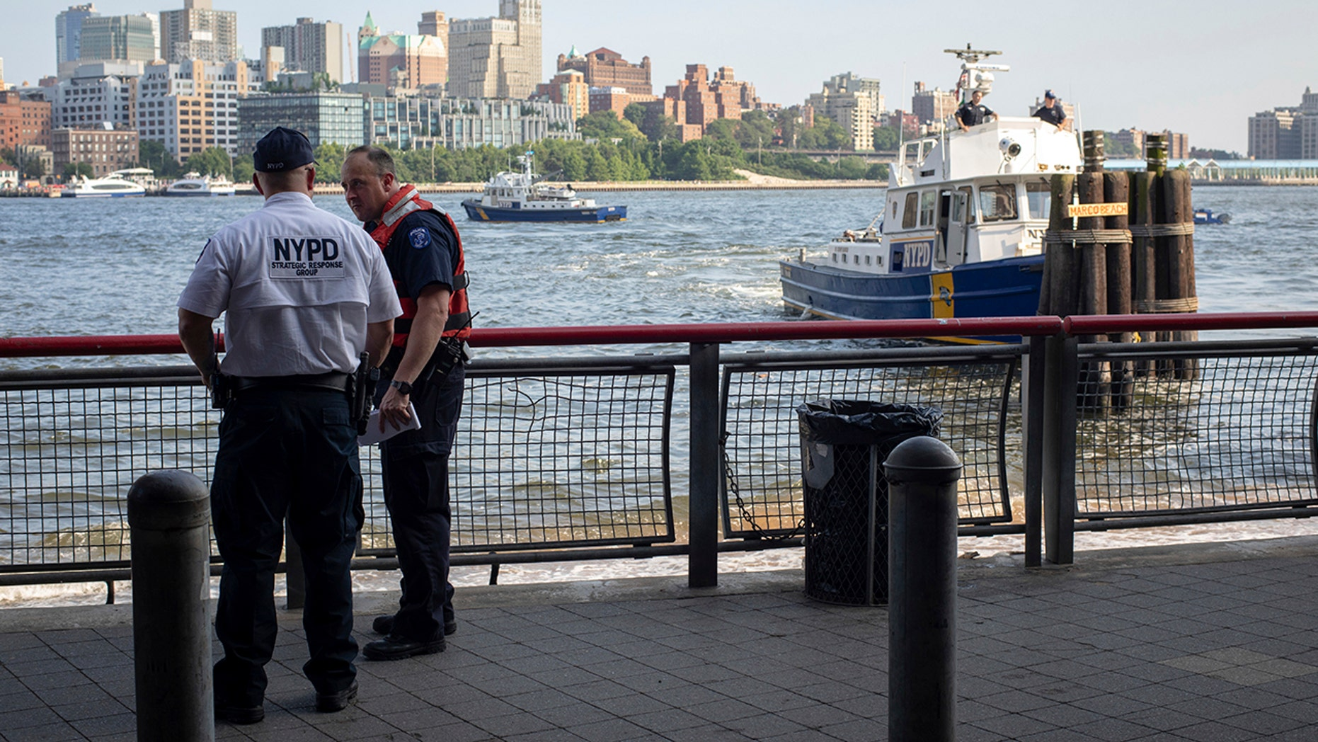 Authorities investigate the death of a baby boy who was found floating in the water near the Brooklyn Bridge in Manhattan, on Sunday, Aug. 5, 2018, in New York.