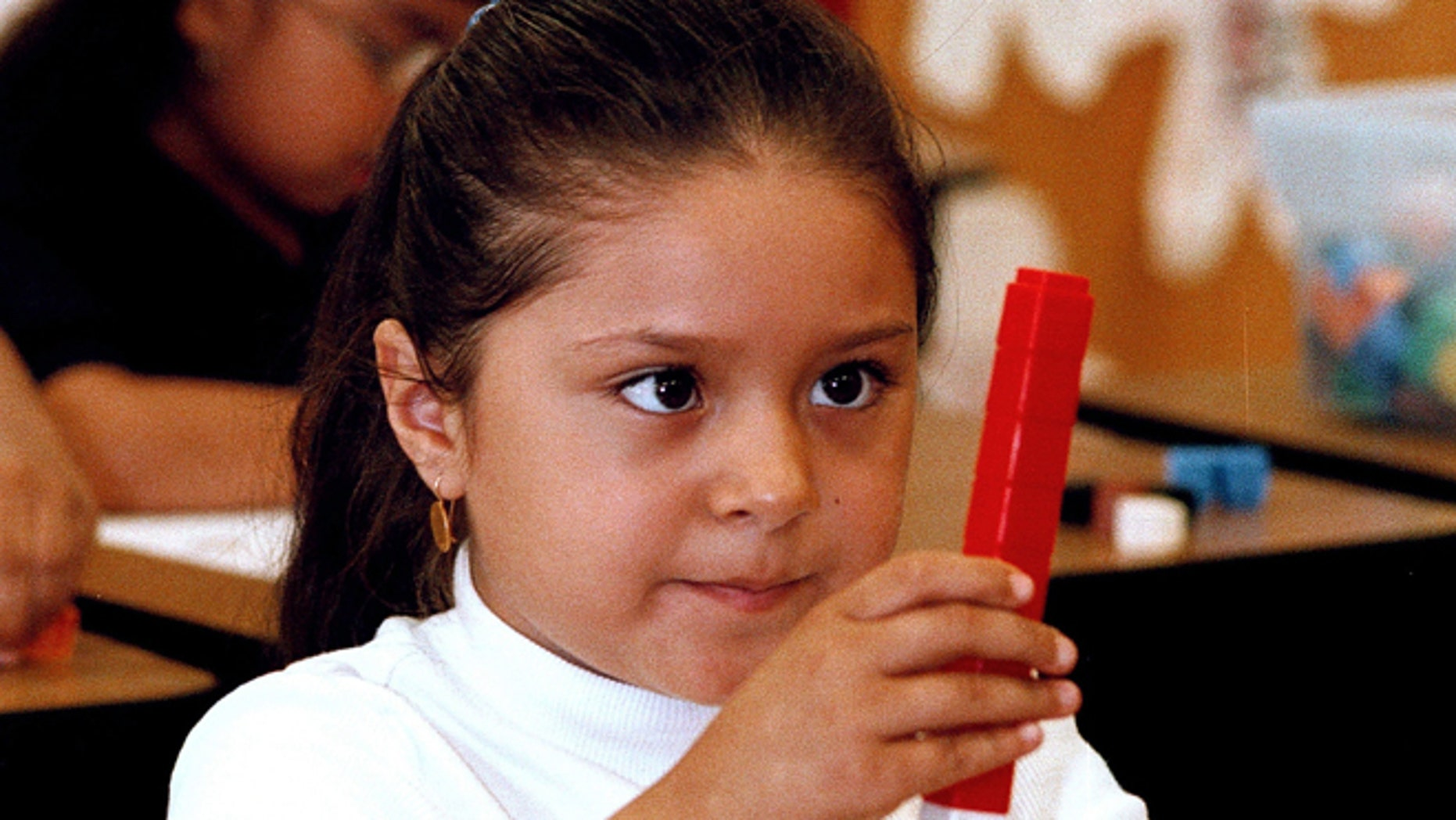 TYLER,TX - SEPTEMBER 11:  Seven-year-old Dulce Oliva constructs a stack of blocks during a math lesson in English at Birdwell Elementary School September 11, 2003 in Tyler, Texas. Oliva is one of the 60 percent of Hispanic students among a student body of 600 at the east Texas school.  (Photo by Mario Villafuerte/Getty Images)